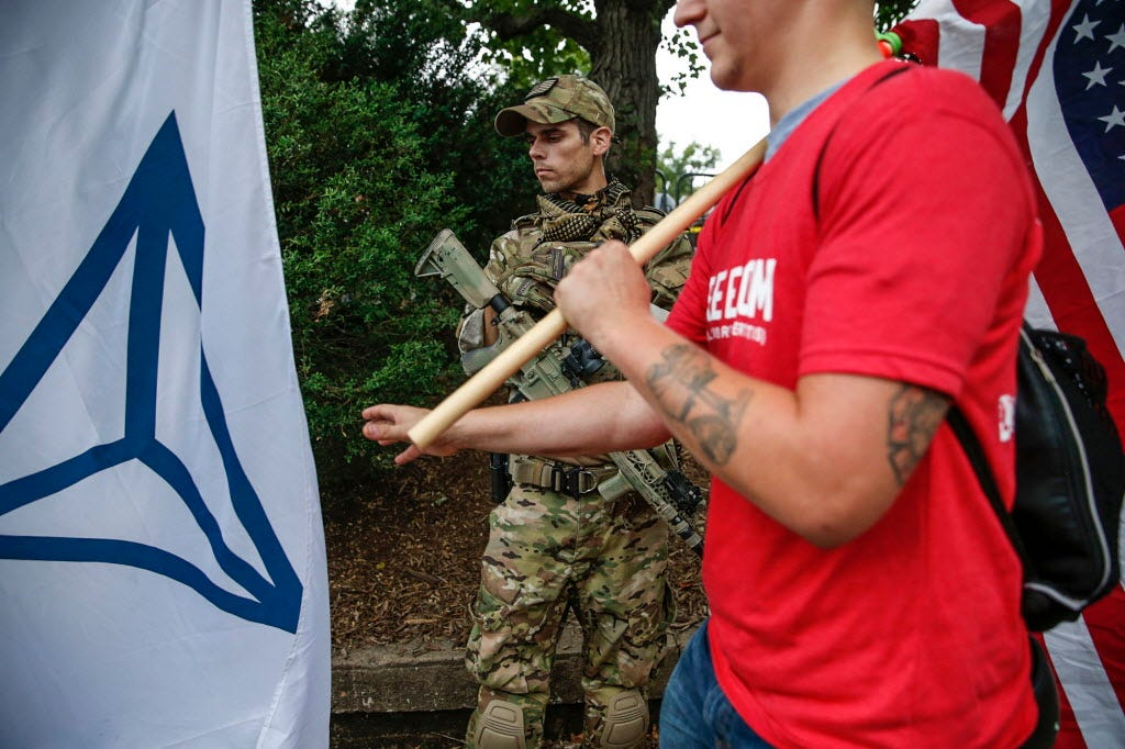 Open-carry militia + protesters = recipe for tragedy