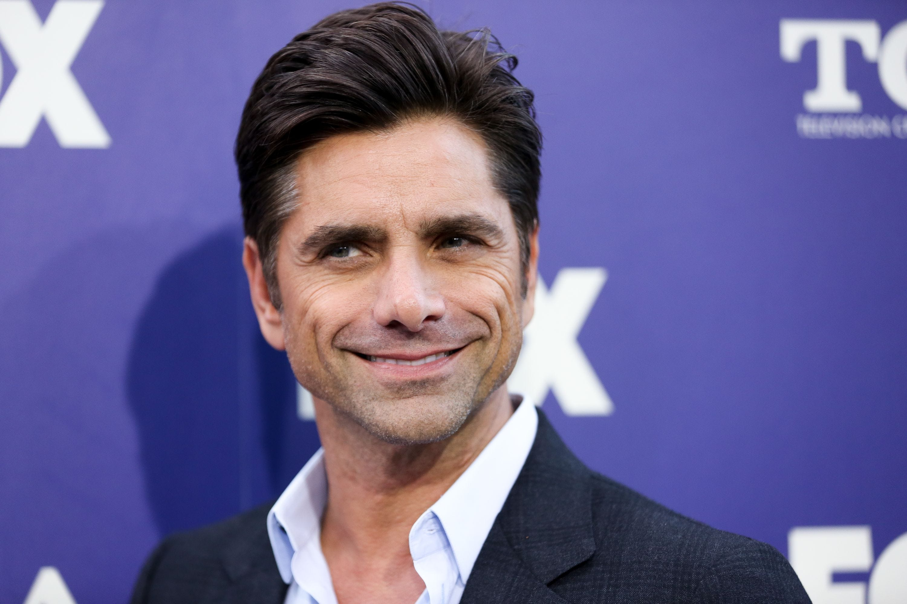 New dad John Stamos reunites with the Beach Boys for emotional Capitol Fourth concert