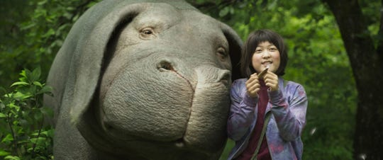 """Korean girl Mija (Ahn Seo Hyun) does her best to protect a lovable super-pig in """"Okja."""""""