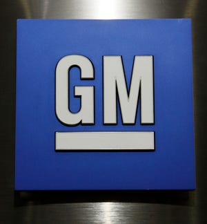 General Motors stock falls on Monday after Goldman Sachs rates the stock a sell. File photo shows GM logo. (AP Photo/Paul Sancya, File)