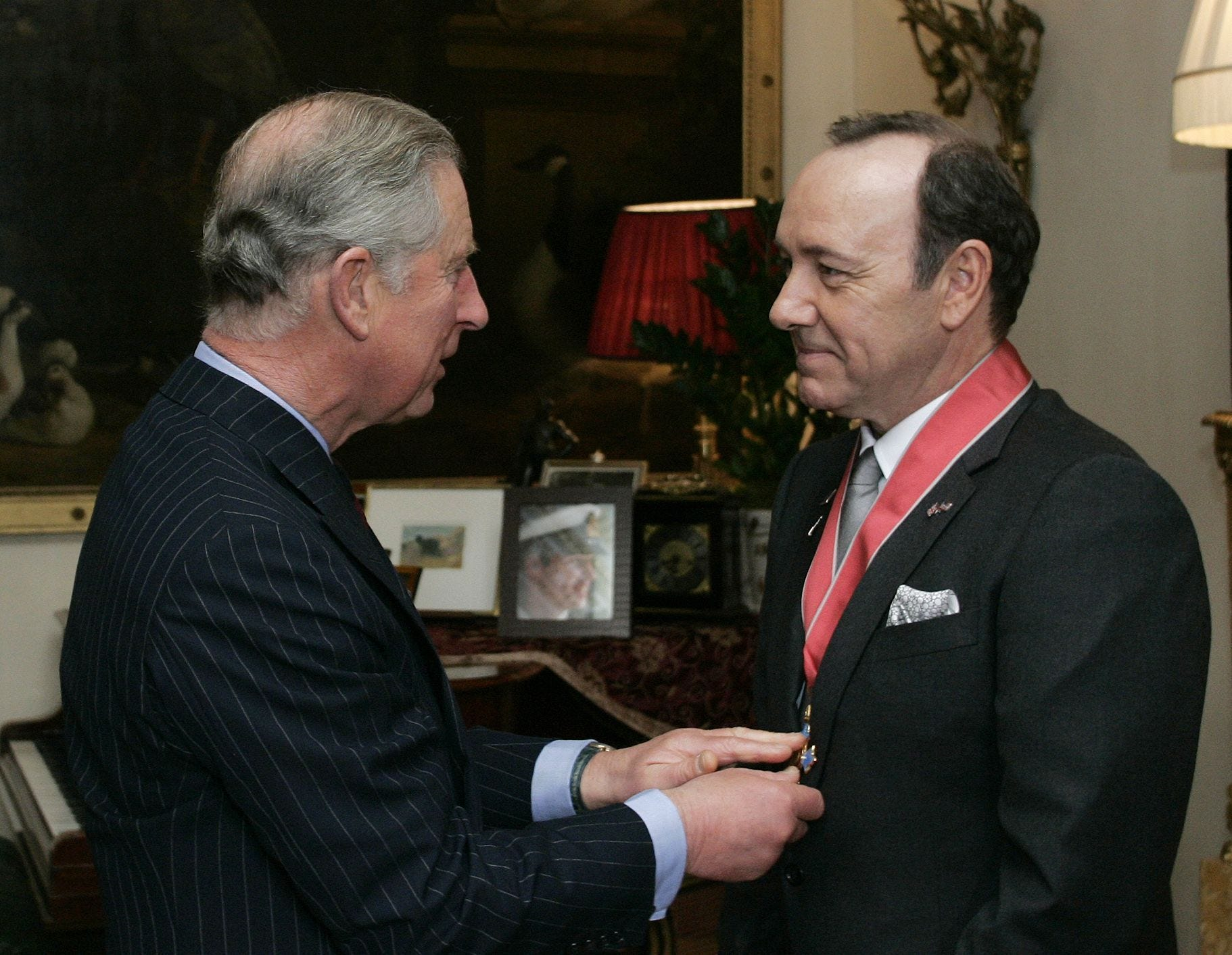 ORG XMIT: LSU103 U.S. actor Kevin Spacey, right, receives