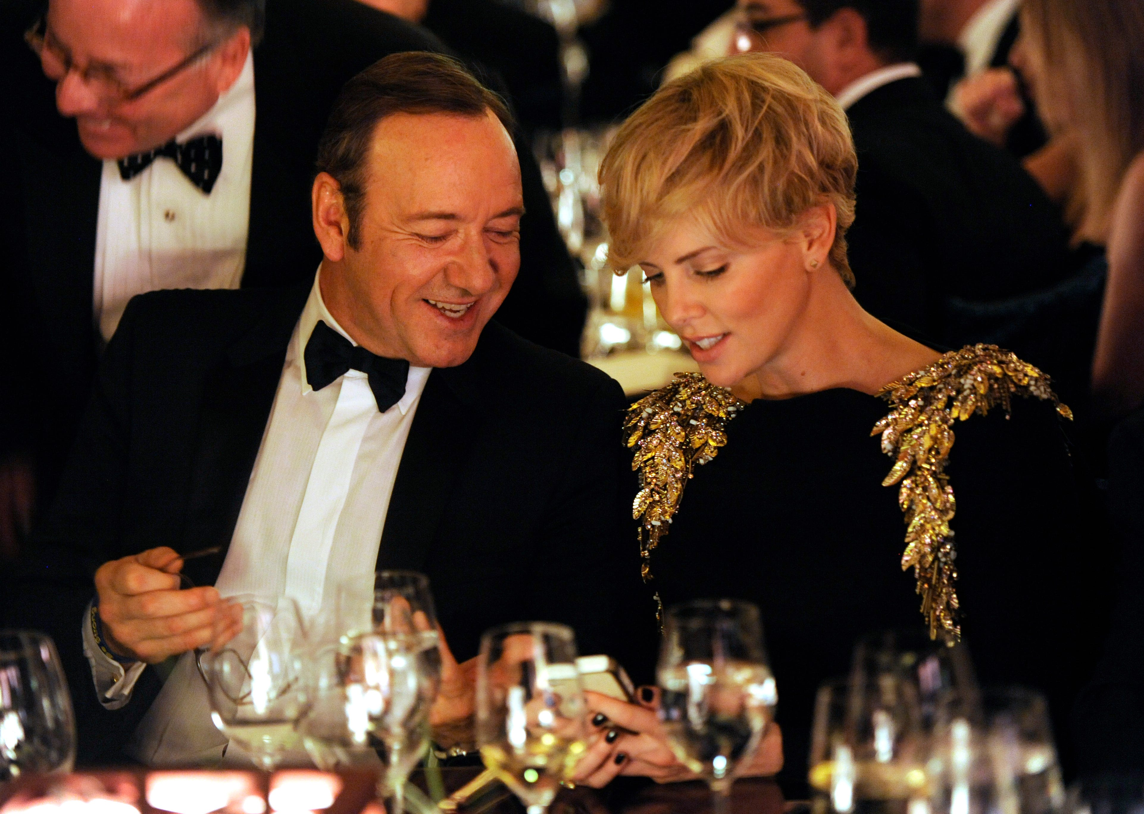 Actors Kevin Spacey, left, and Charlize Theron attend