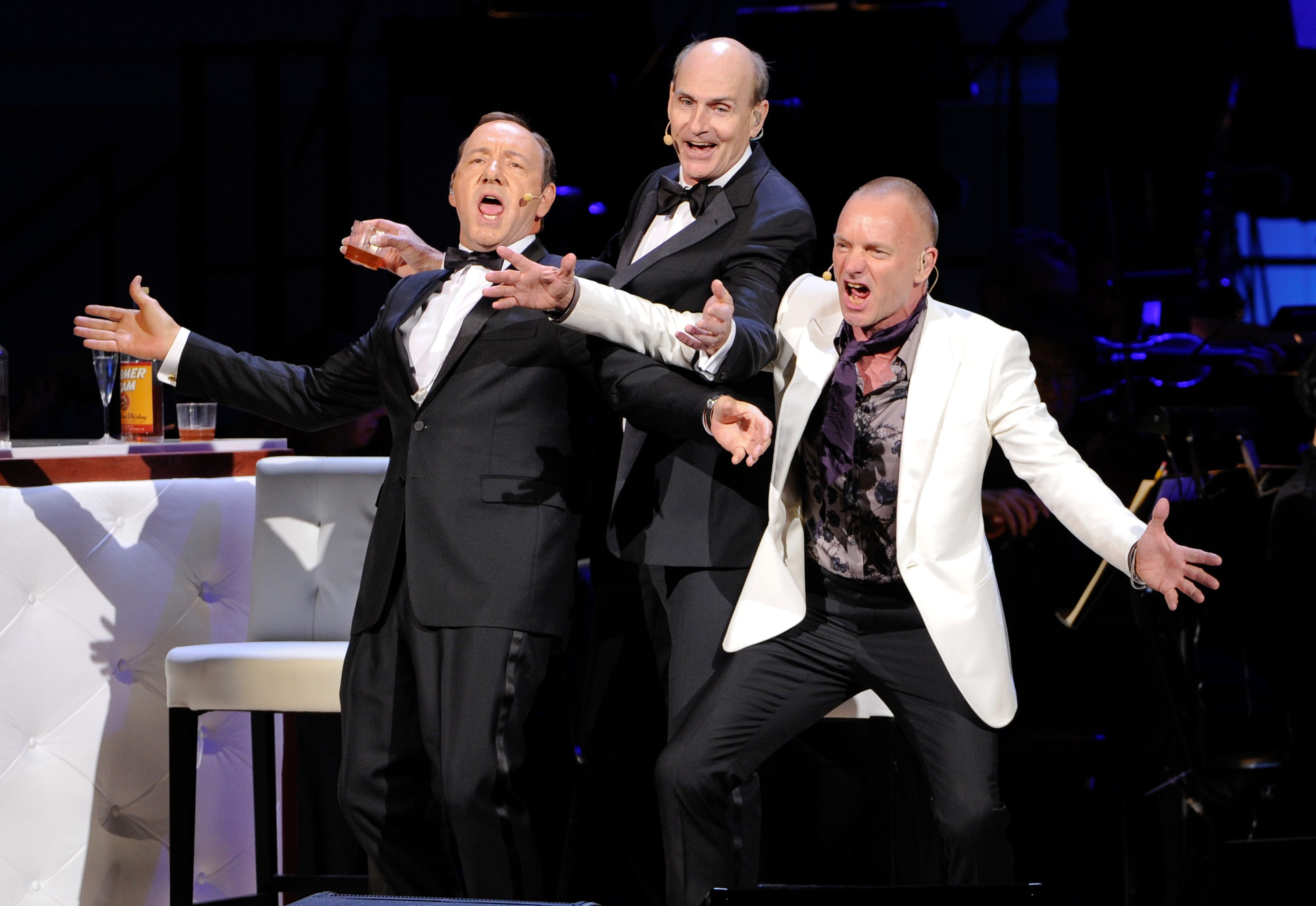Actor Kevin Spacey, left, performs with singers James