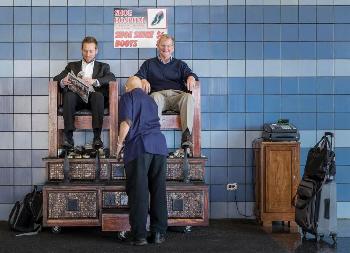 Airport shoeshine stands still on their feet
