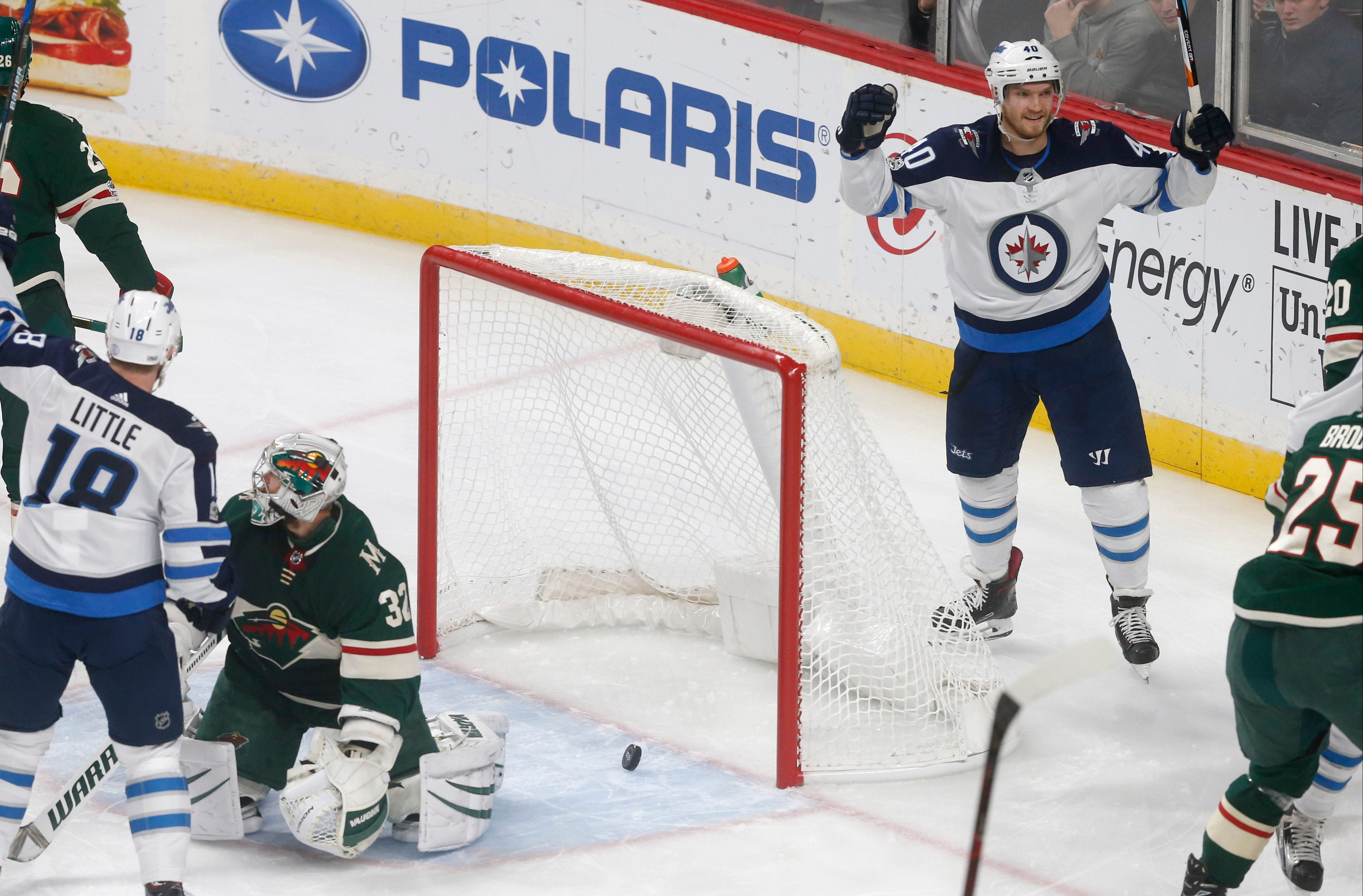 Hellebuyck, Jets continue roll with 2-1 win against Wild