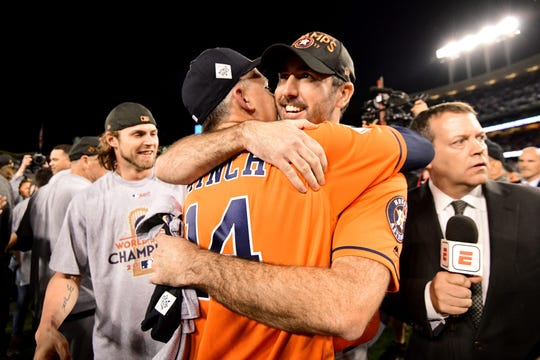 Houston Astros' Justin Verlander celebrates with manager AJ Hinch after beating the Los Angeles Dodgers 5-1 in Game 7 to win the World Series at the Dodger Stadium on November 1, 2017 in Los Angeles.