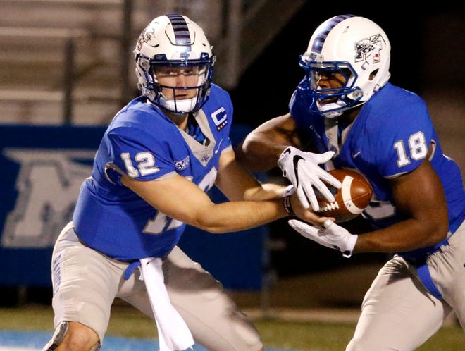 MTSUÕs quarterback Brent Stockstill (12) hands the ball off to Tavares Thomas (18) during the game against UTEP, on Saturday, Nov. 4, 2017, at MTSU.