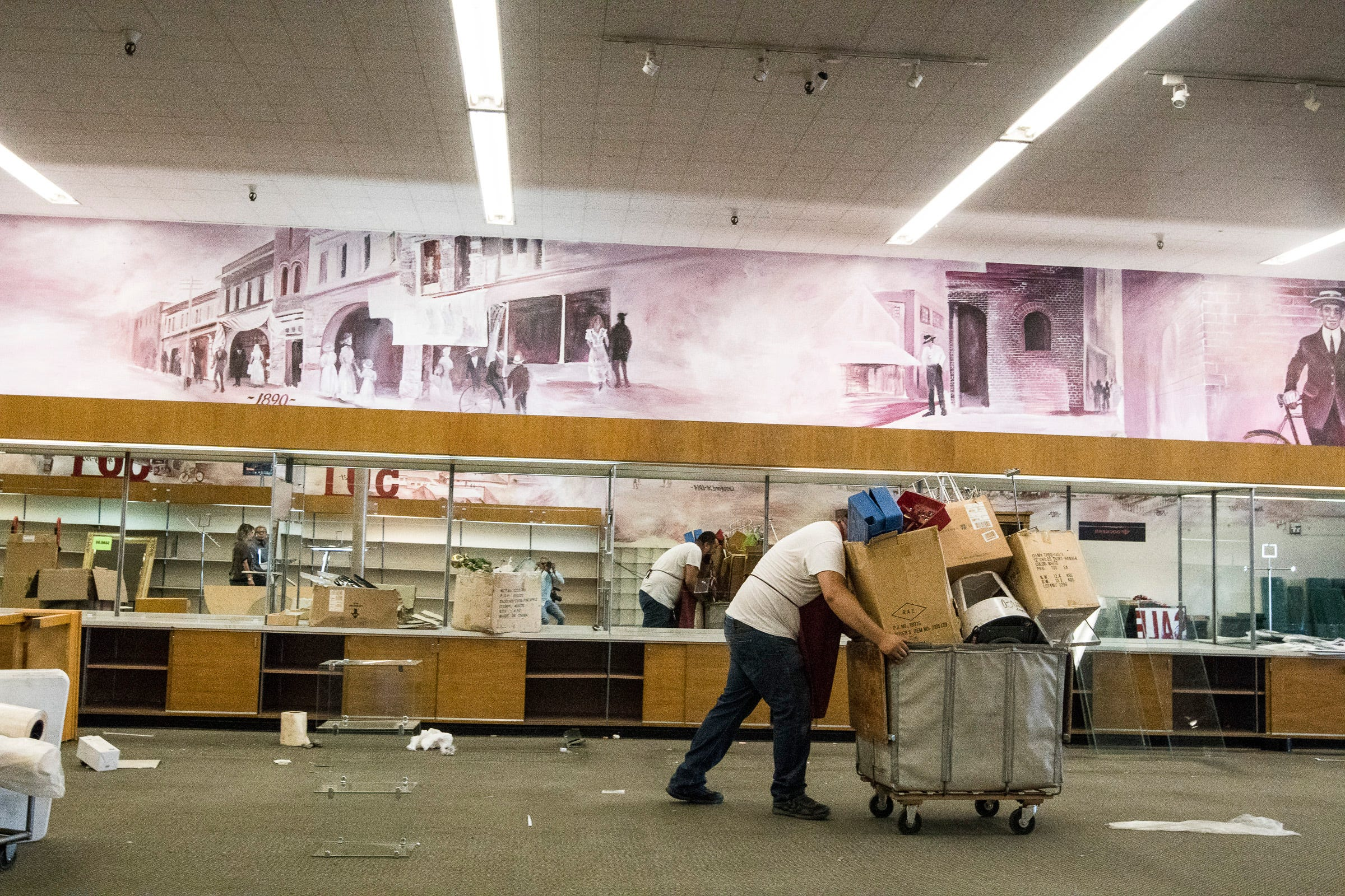 Employees move furniture and other belongings before