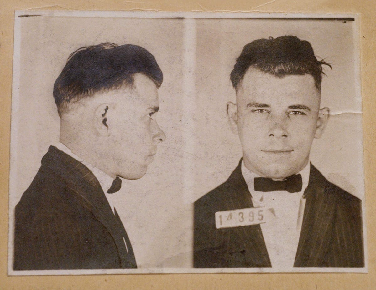 Why do some people smile in their mugshots? Experts and