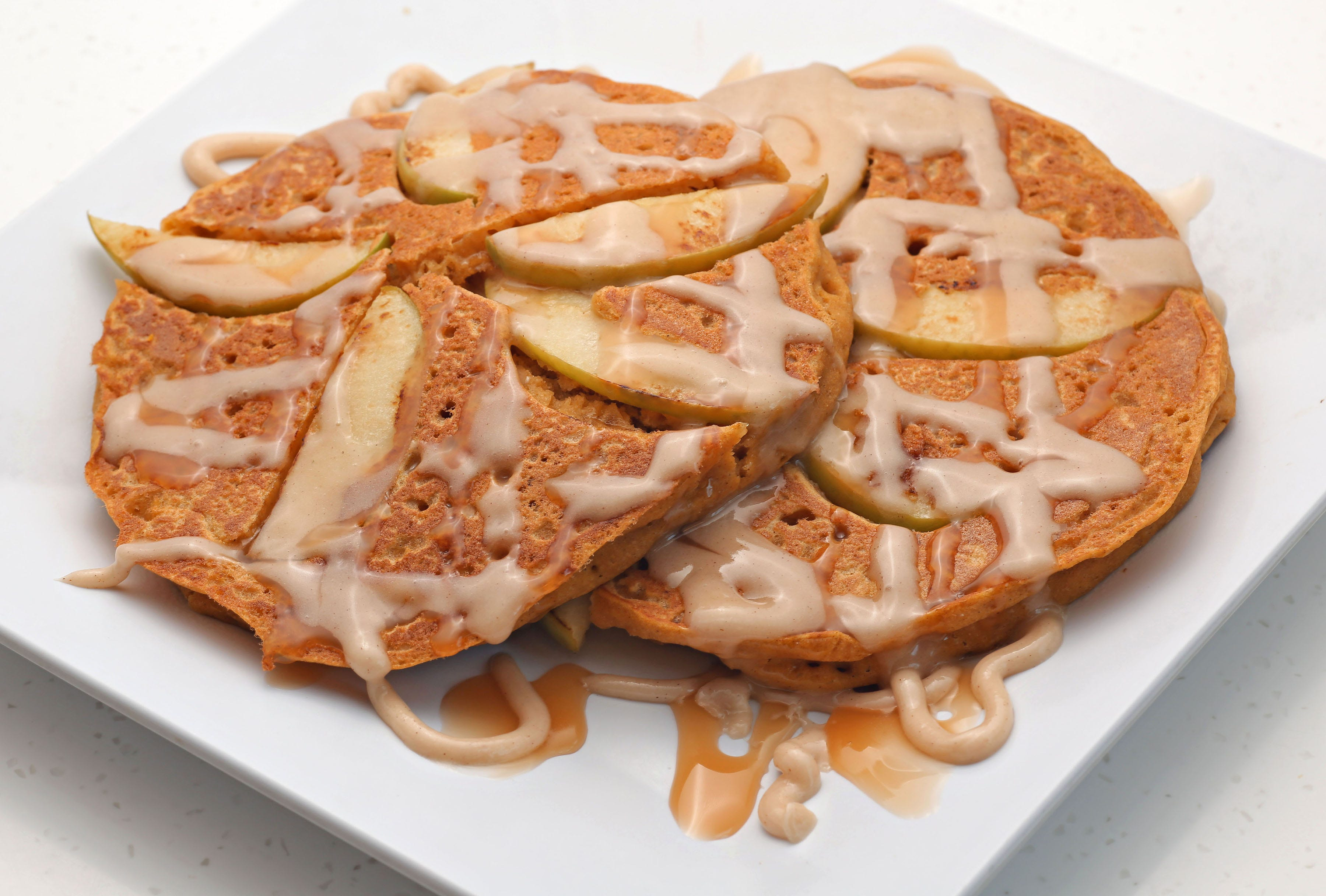 Scramble's apple pumpkin pancakes are drizzled with