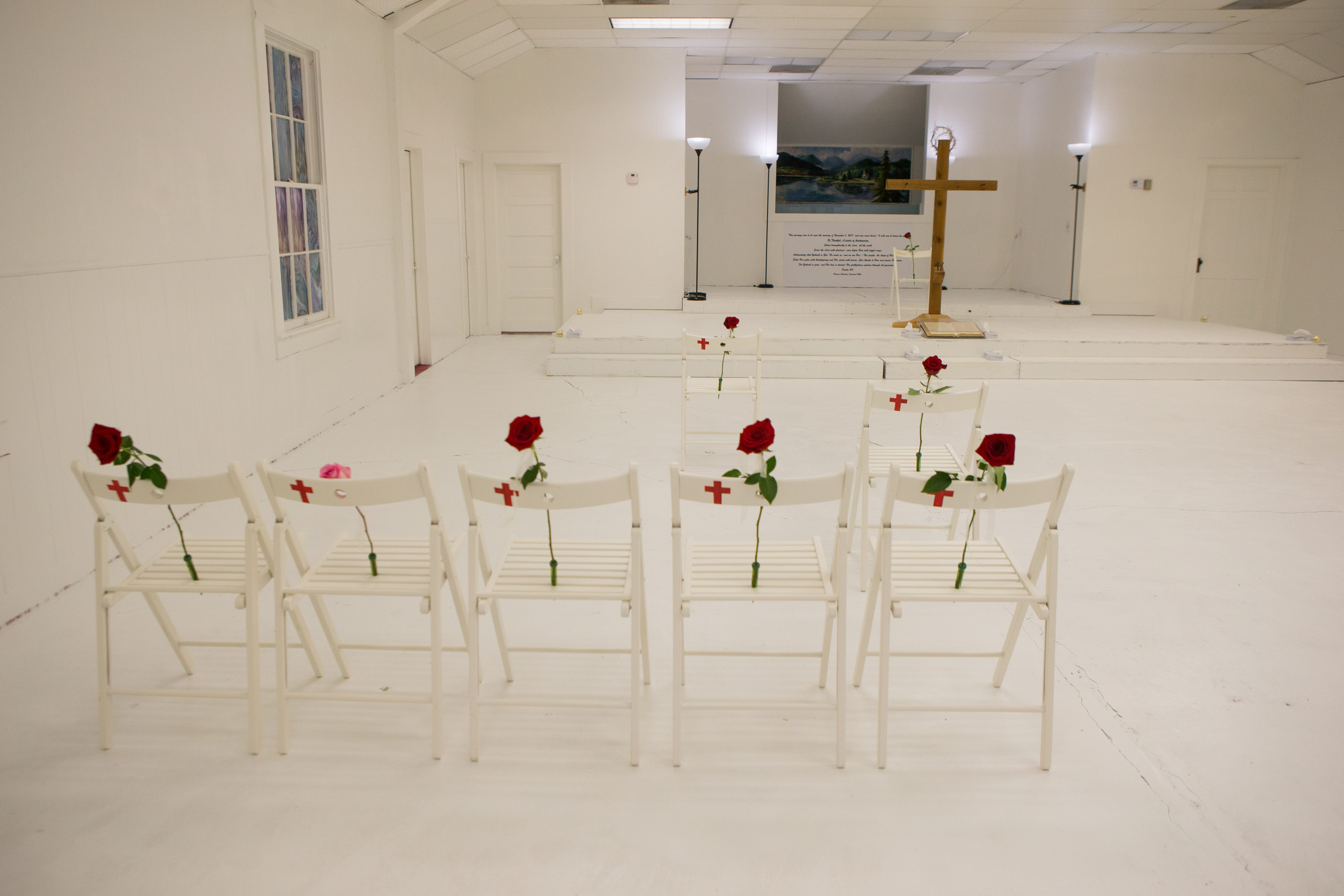 Chairs with flowers were placed in the sanctuary of First Baptist Church of Sutherland Springs in 2017 as a memorial to honor those who died in a mass shooting at the church. Twenty five people were killed including a pregnant woman.
