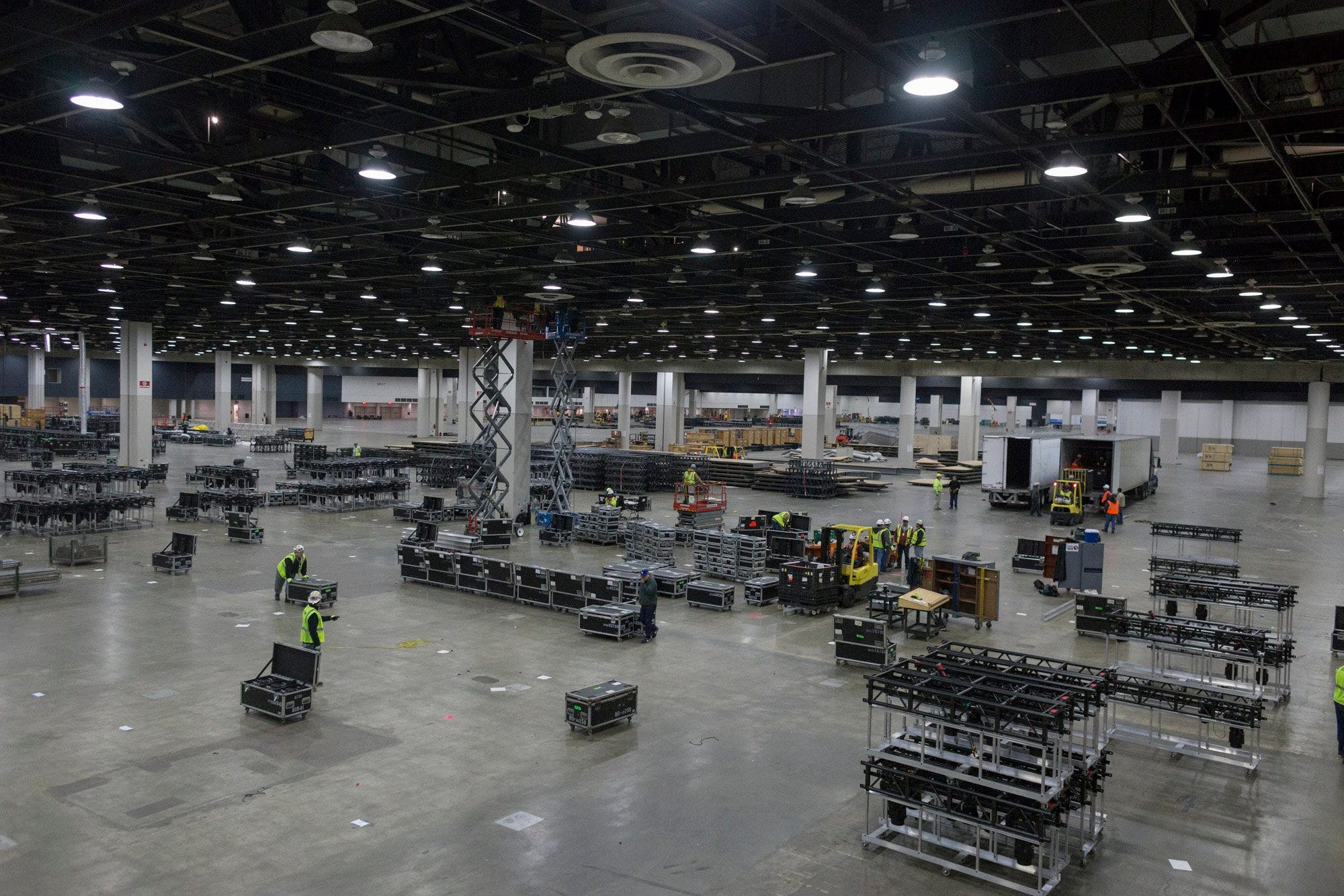 Construction crews load in lighting trusses at Cobo