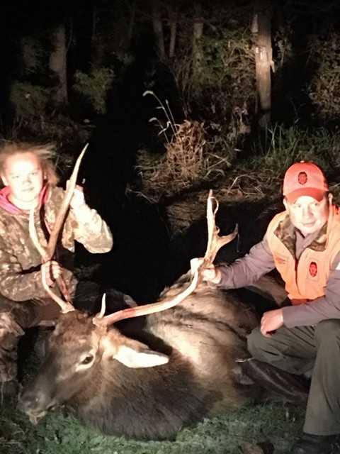 Abby Wilson, left, and MDC agent Adam Doerhoff, after Abby accidentally shot this bull elk Saturday, thinking it was a big white-tail buck. (Photo: Donald White)