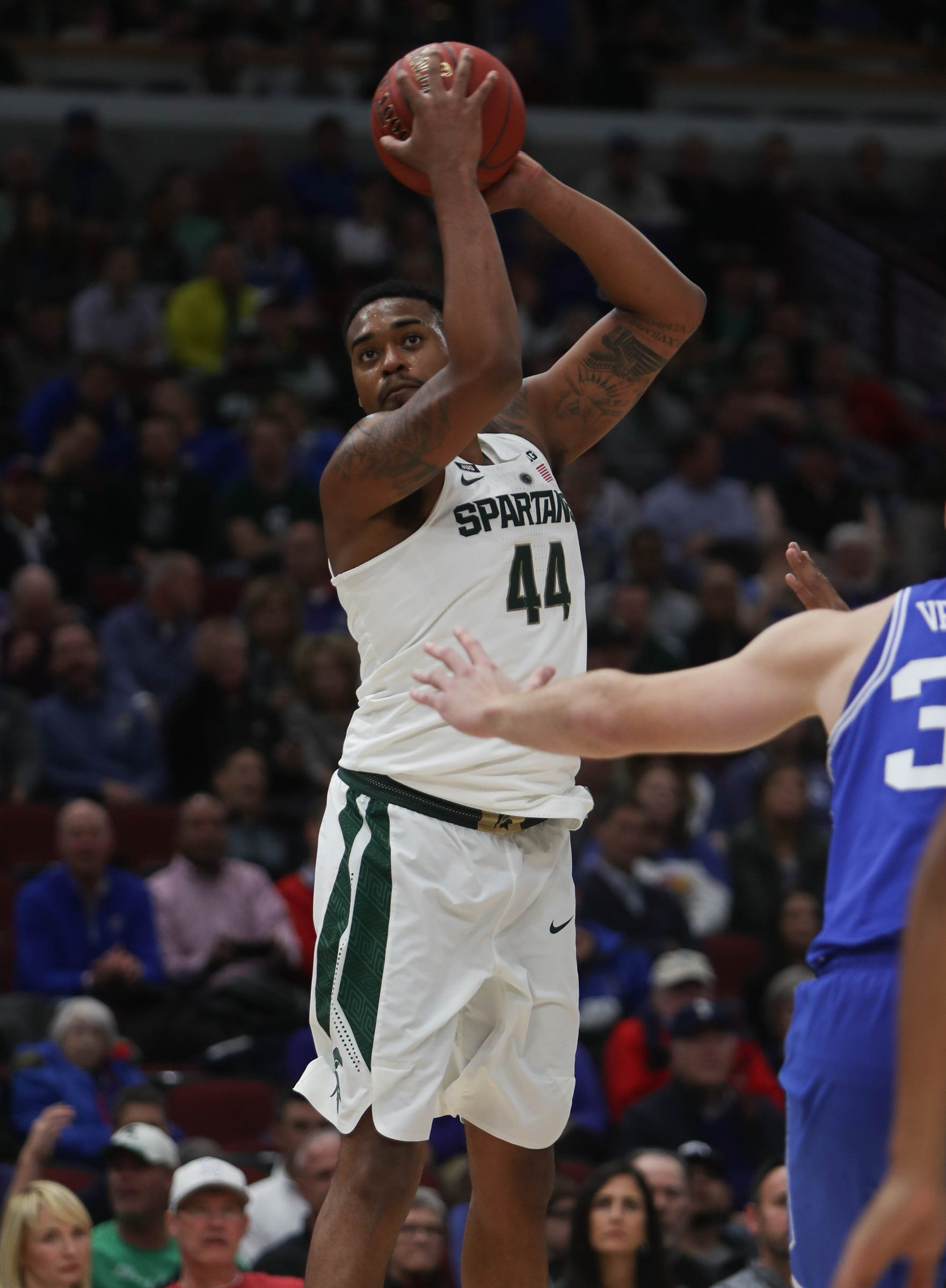 Michigan State's Nick Ward rebounds against Duke during