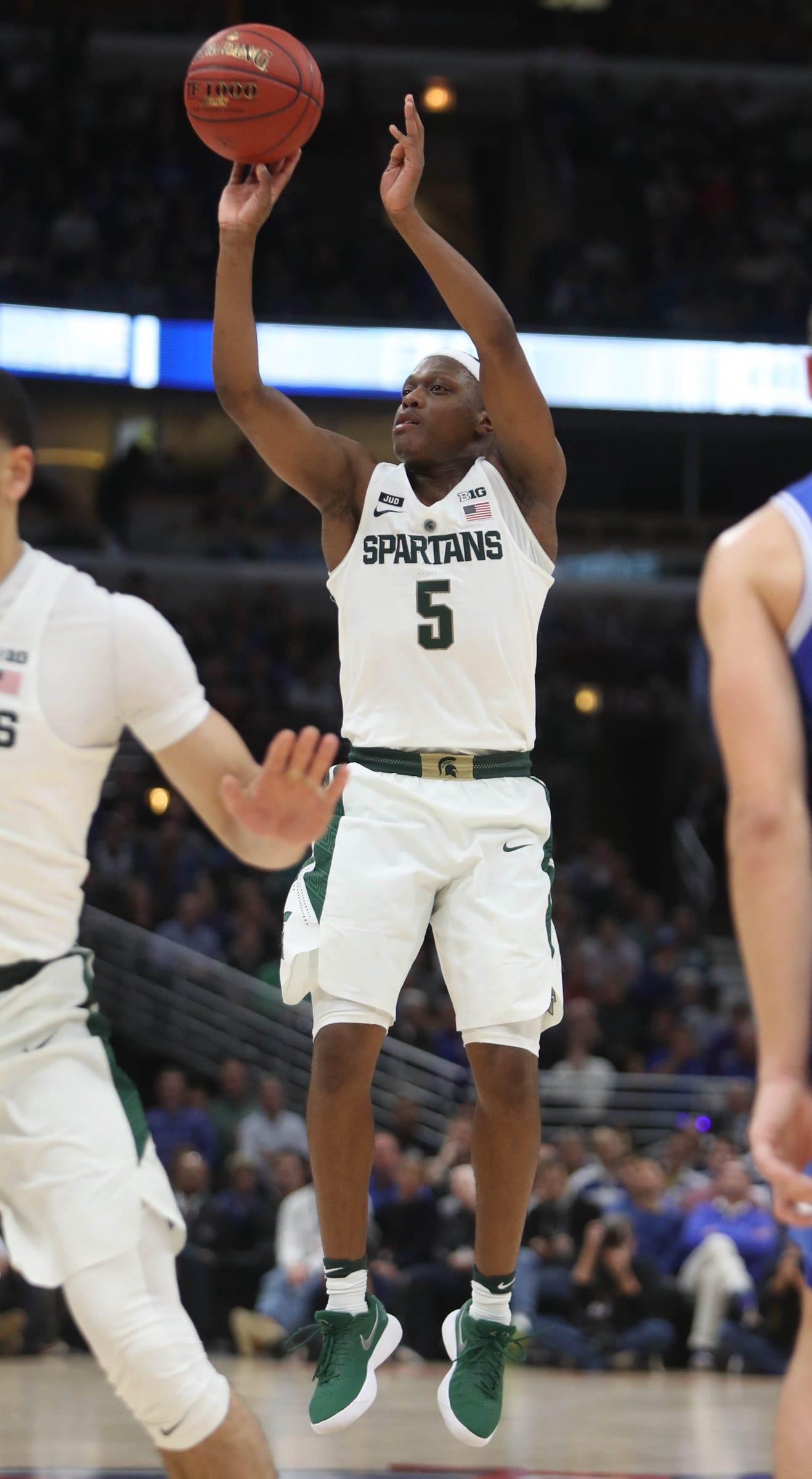 Michigan State's Cassius Winston shoots against Duke