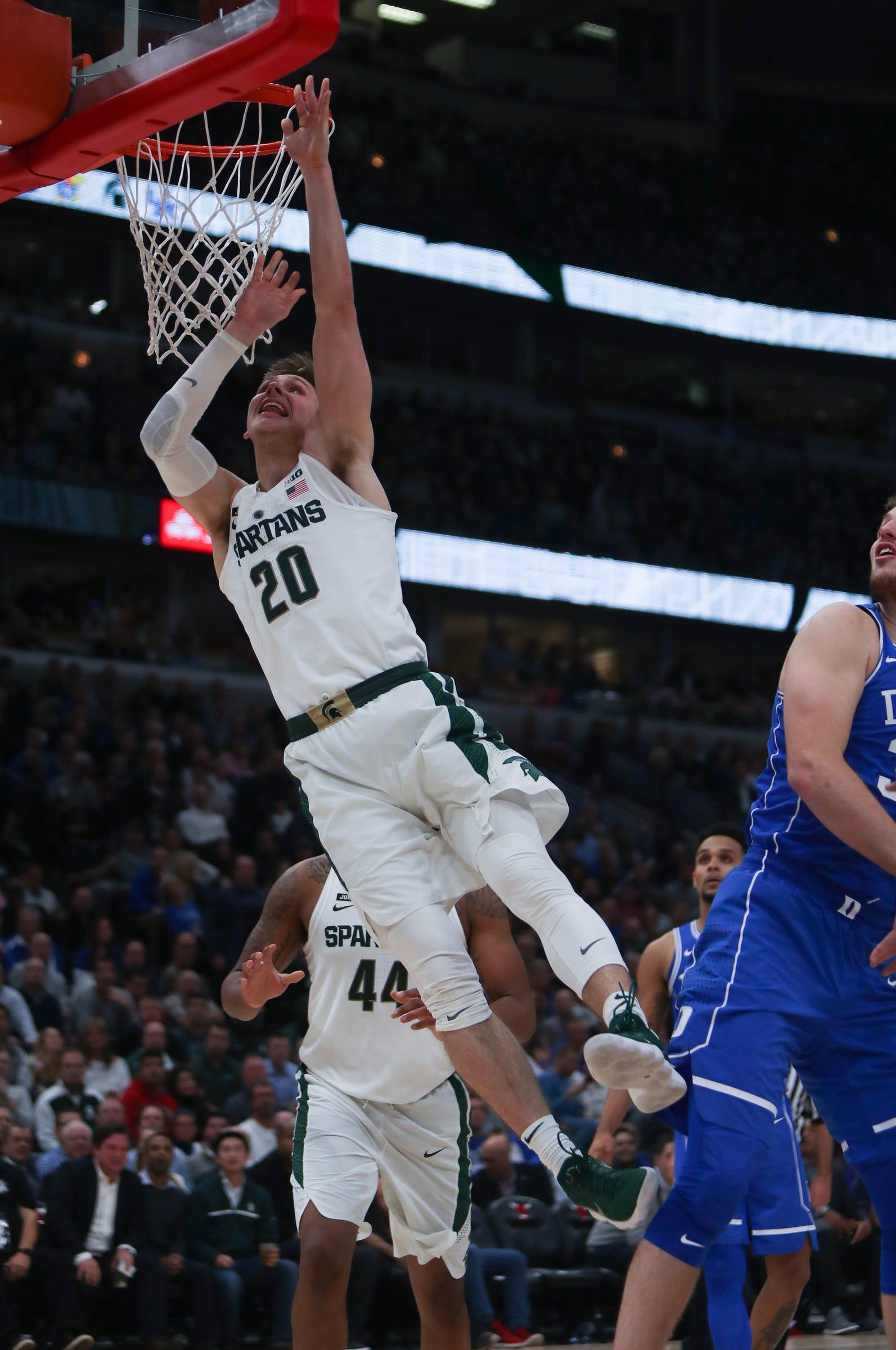 Michigan State's Matt McQuaid drives against Duke during