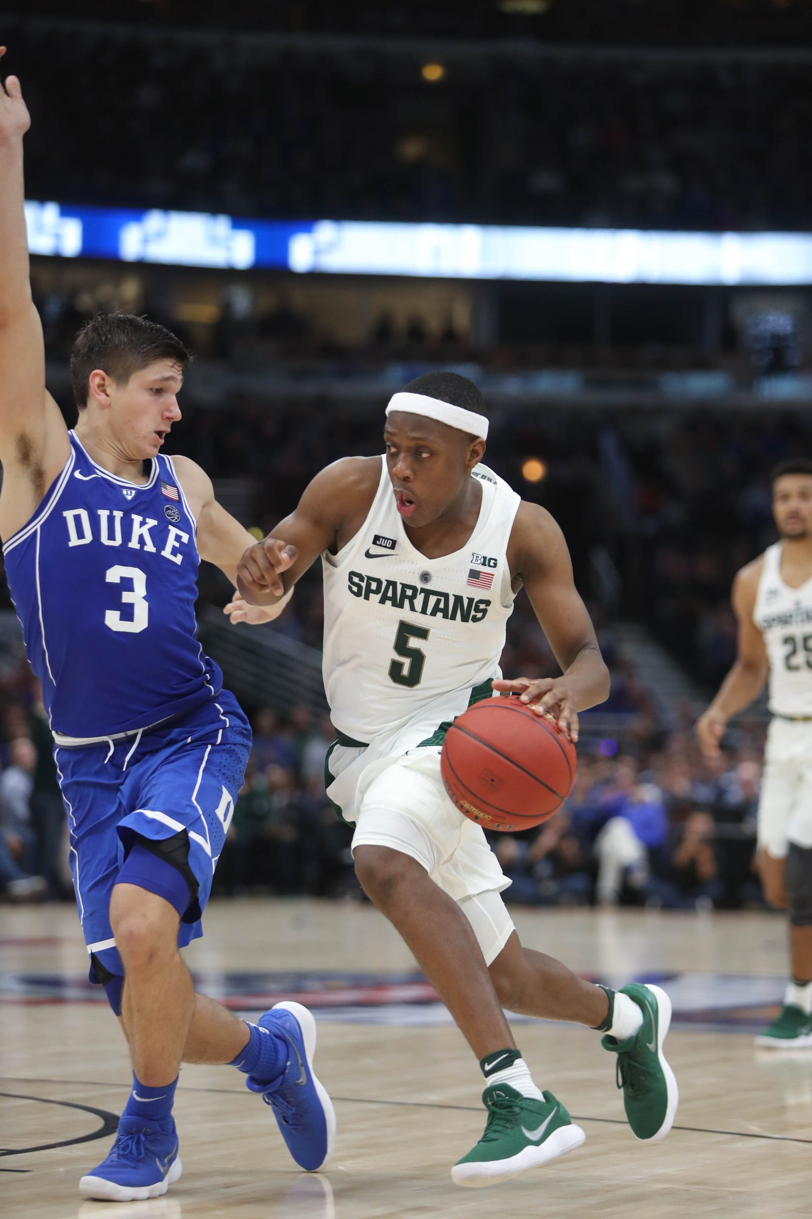 Michigan State's Cassius Winston drives against Duke's