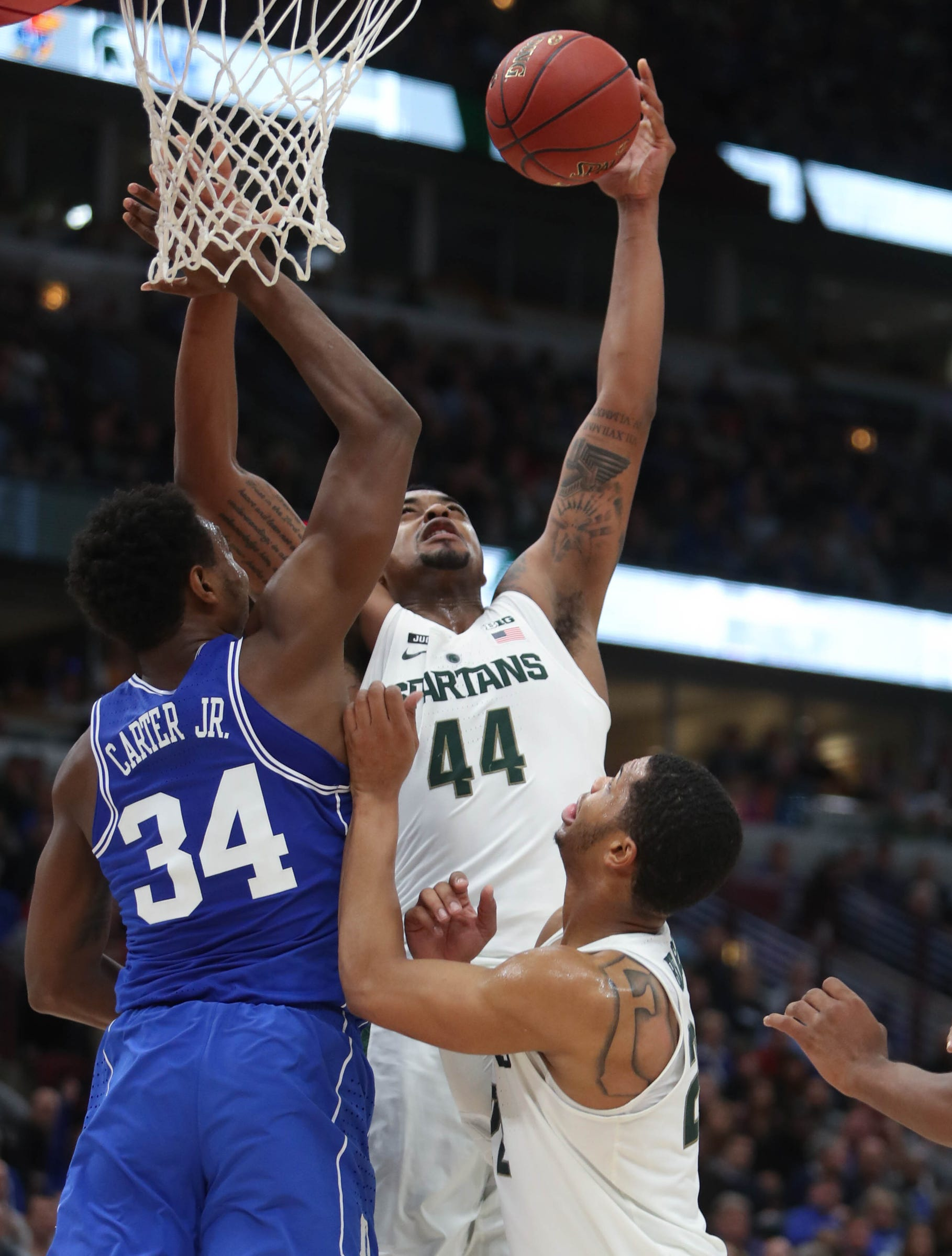 Michigan State's Nick Ward scores against Duke's Wendell