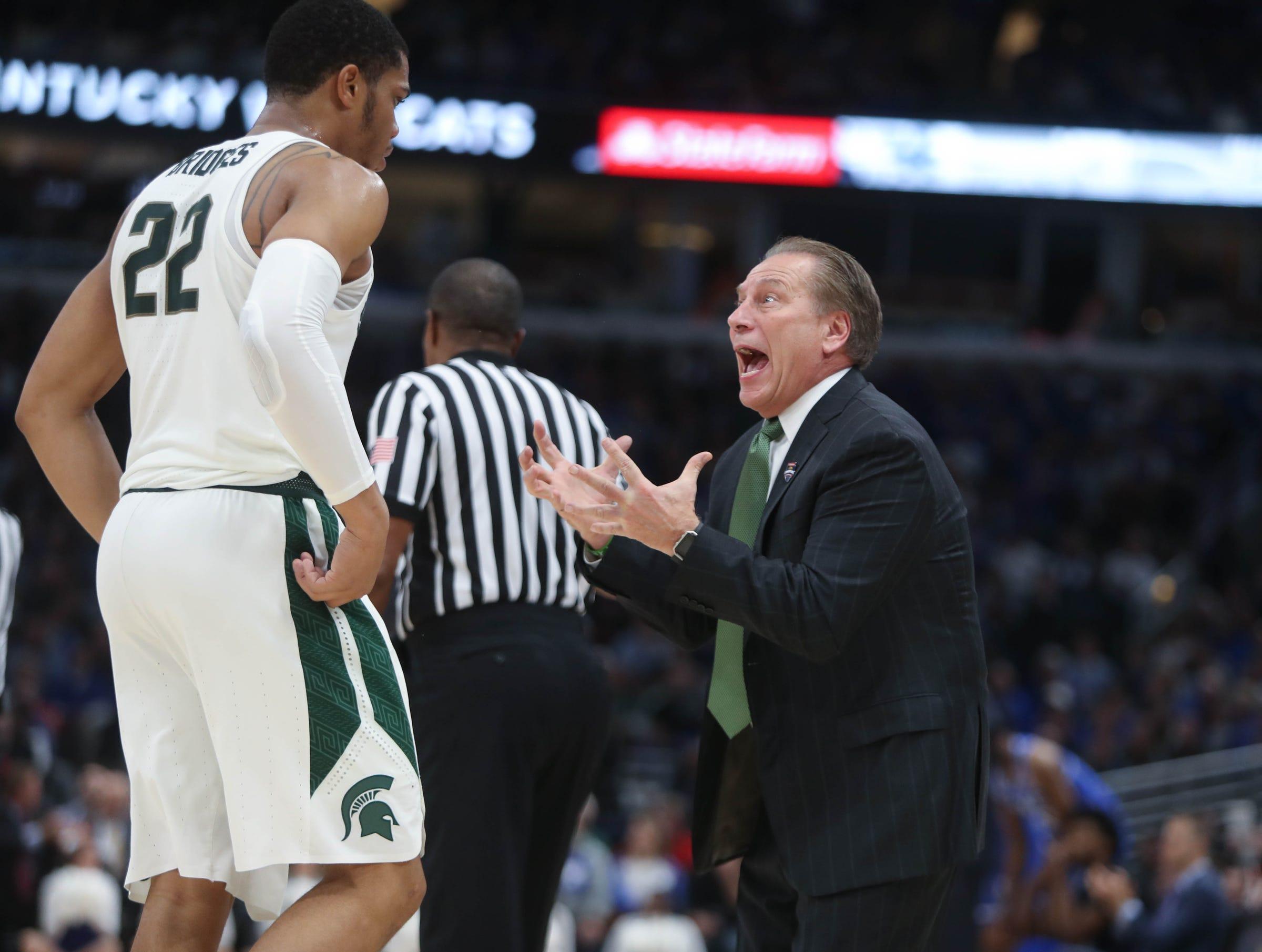 Michigan State coach Tom Izzo talks with Miles Bridges