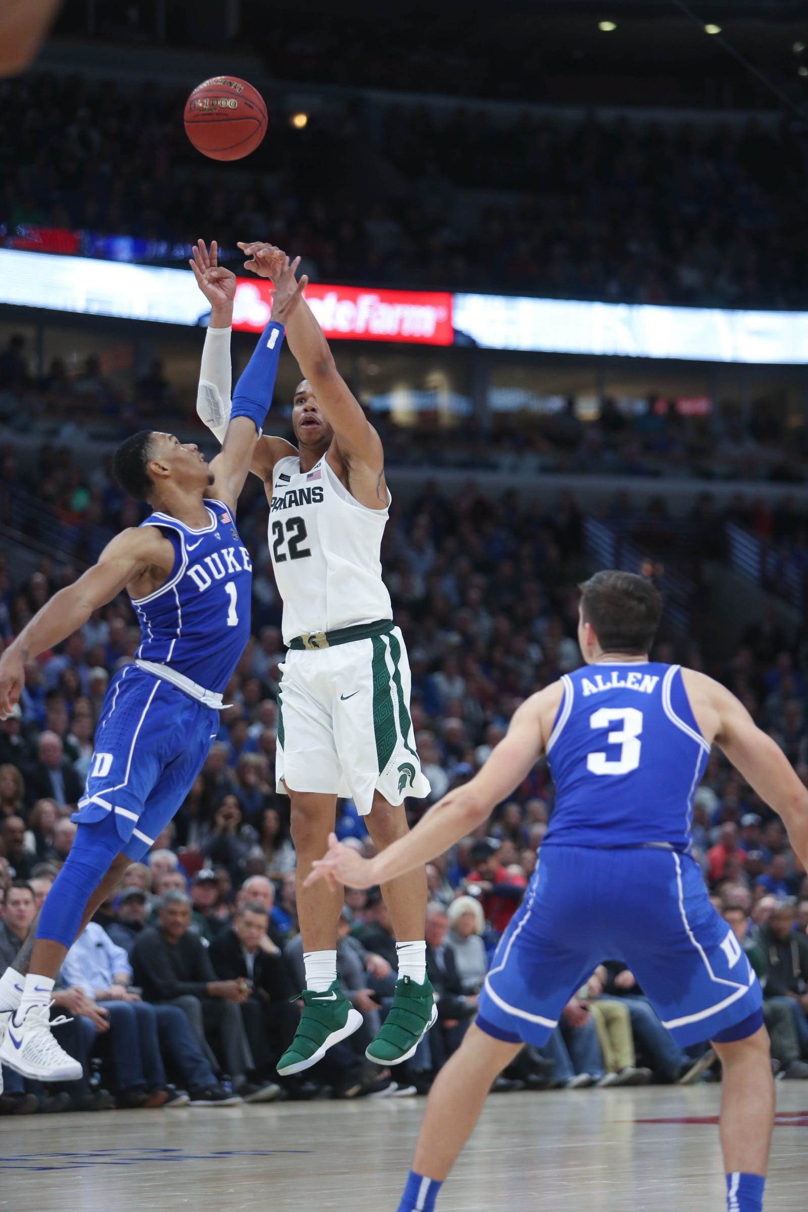 Michigan State's Miles Bridges scores against Duke's