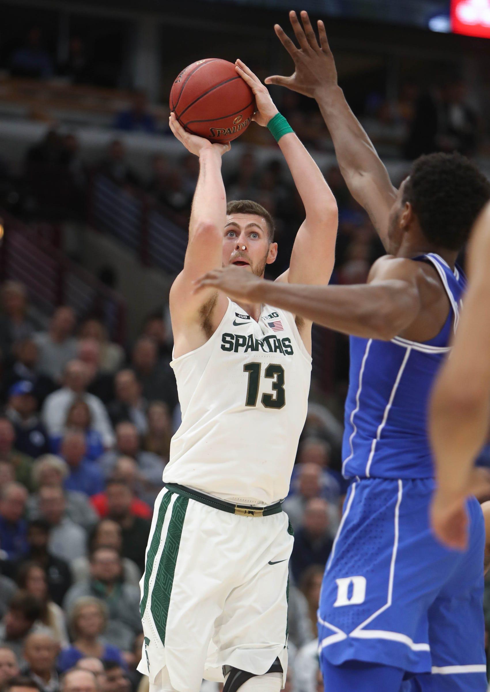 Michigan State's Ben Carter shoots against Duke during