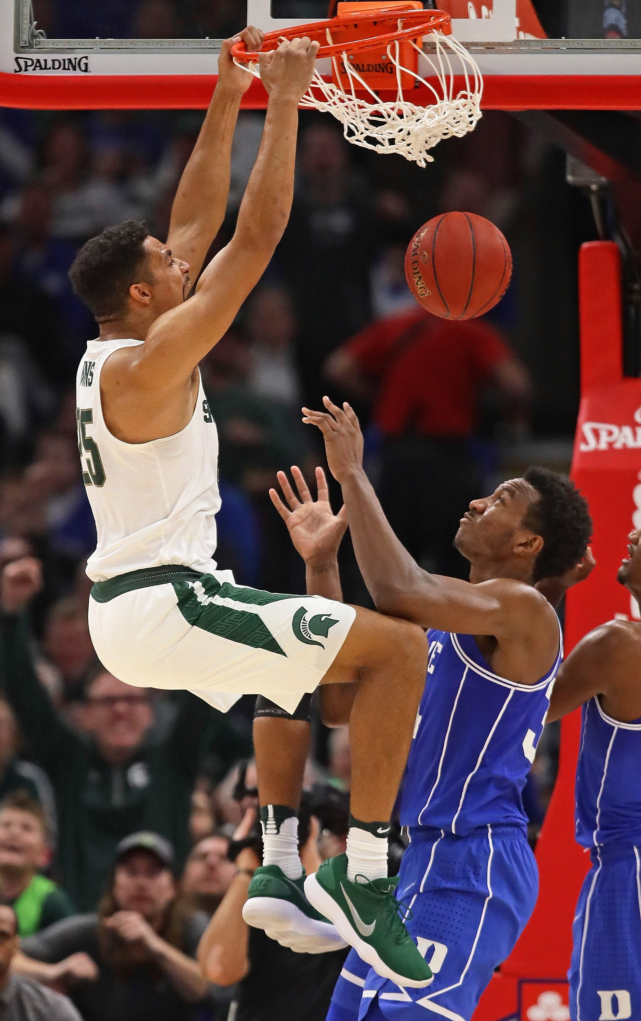 Michigan State's Kenny Goins dunks over Duke's Wendell