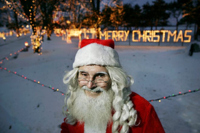 Journal & Courier file photo Calvin Cottrell has been putting up lights at his farm south of Rossville each Christmas season since 1977. Santa Claus will not be able to visit Cottrell's light display this year because he has other places he has to be. But the display, which as 900,000 lights, brightens the holiday, as well as the surrounding countryside.