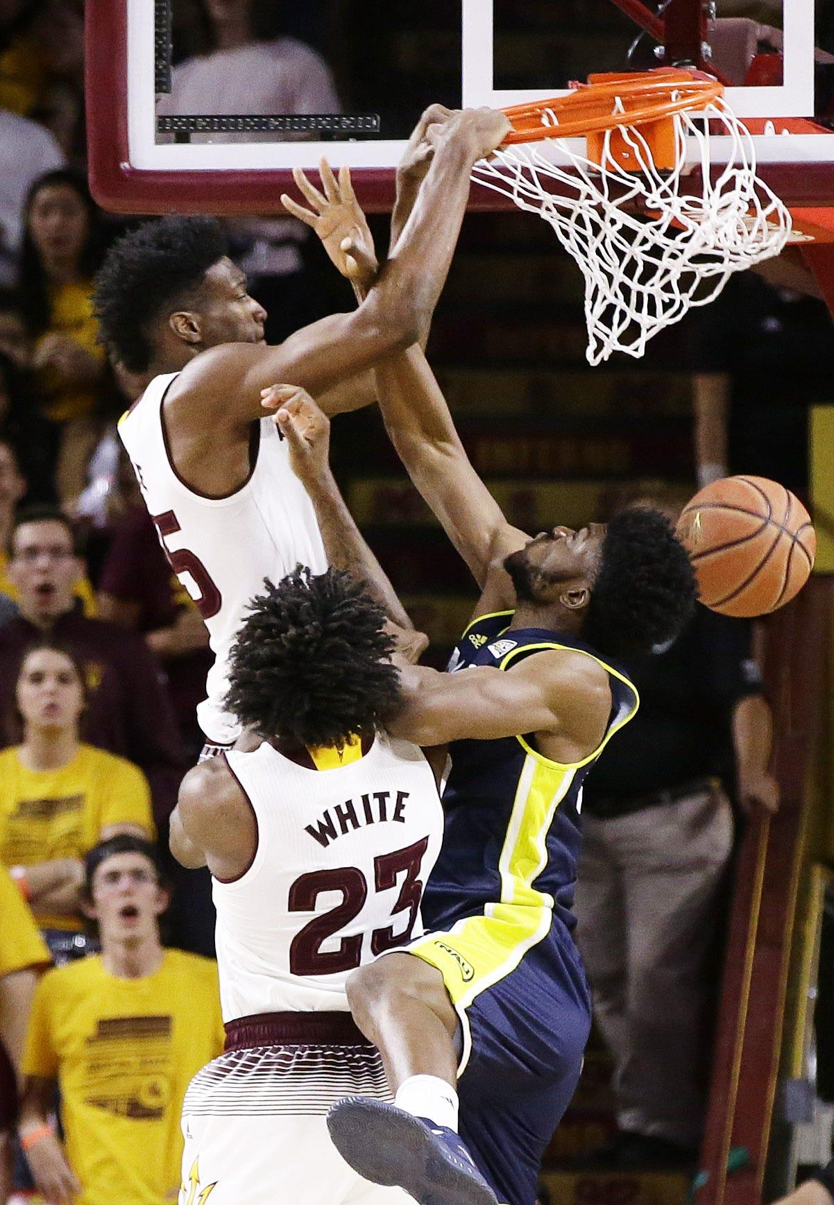 Arizona State forward De'Quon Lake dunks the ball over