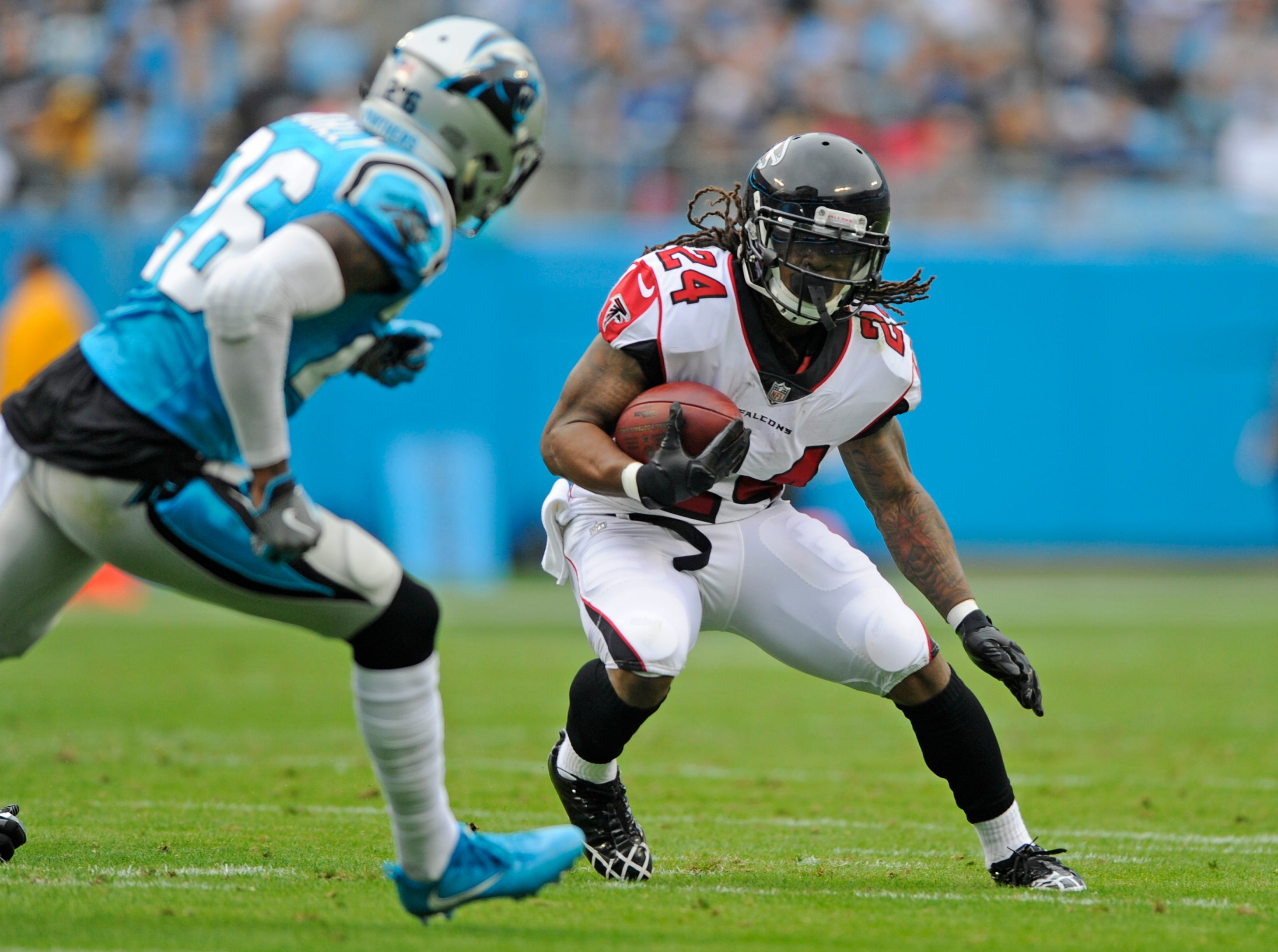 Coleman takes Falcons' lead role after Freeman's concussion