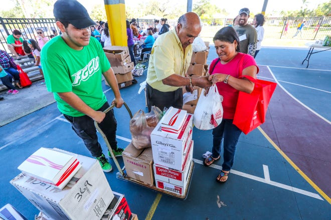 Israel Suarez, CEO of Nations Association, helps distribute food at a 2017 event coordinated by Nations Association along with a health fair.