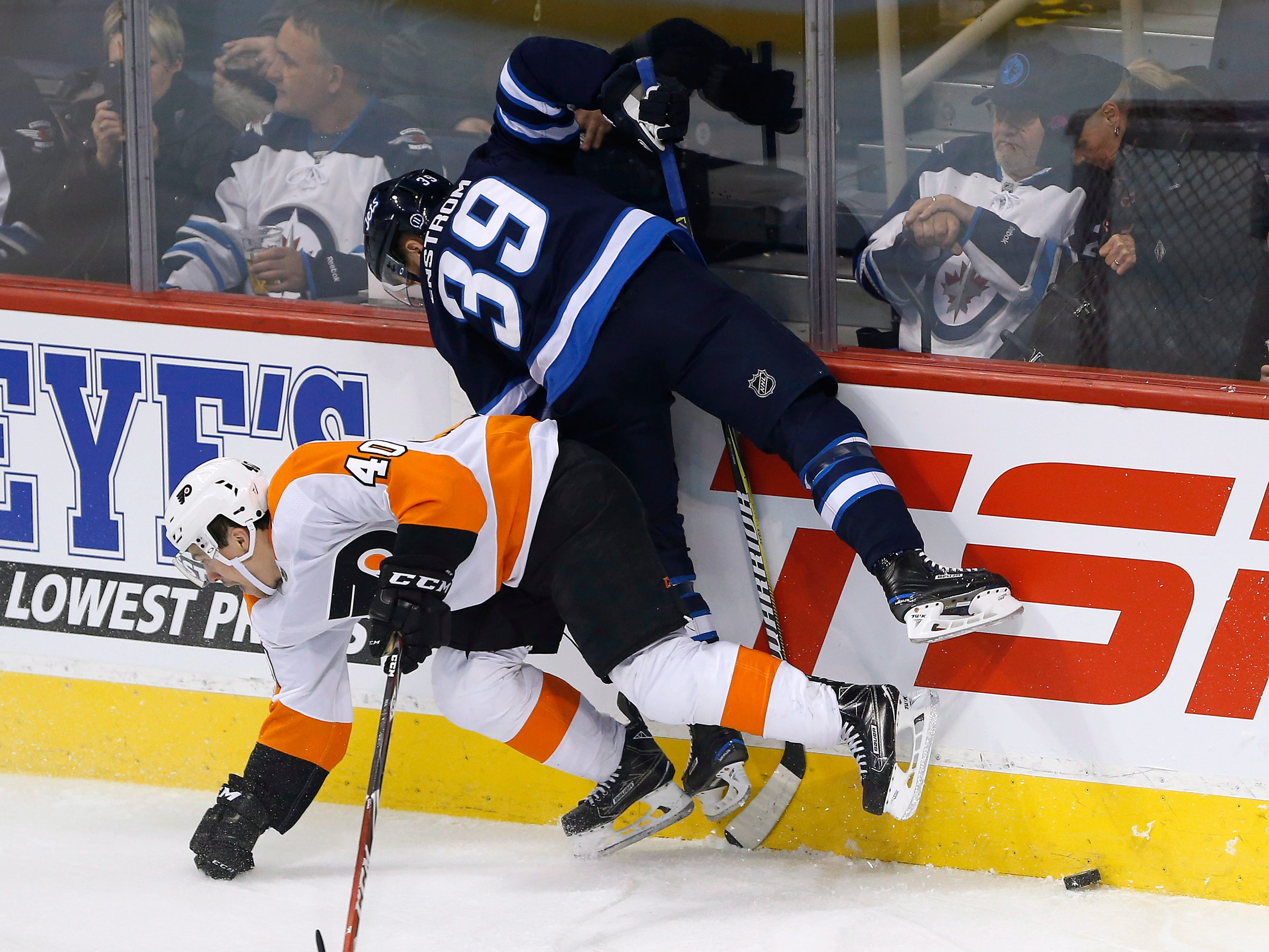 Jets defenseman Enstrom out 8 weeks with a lower-body injury