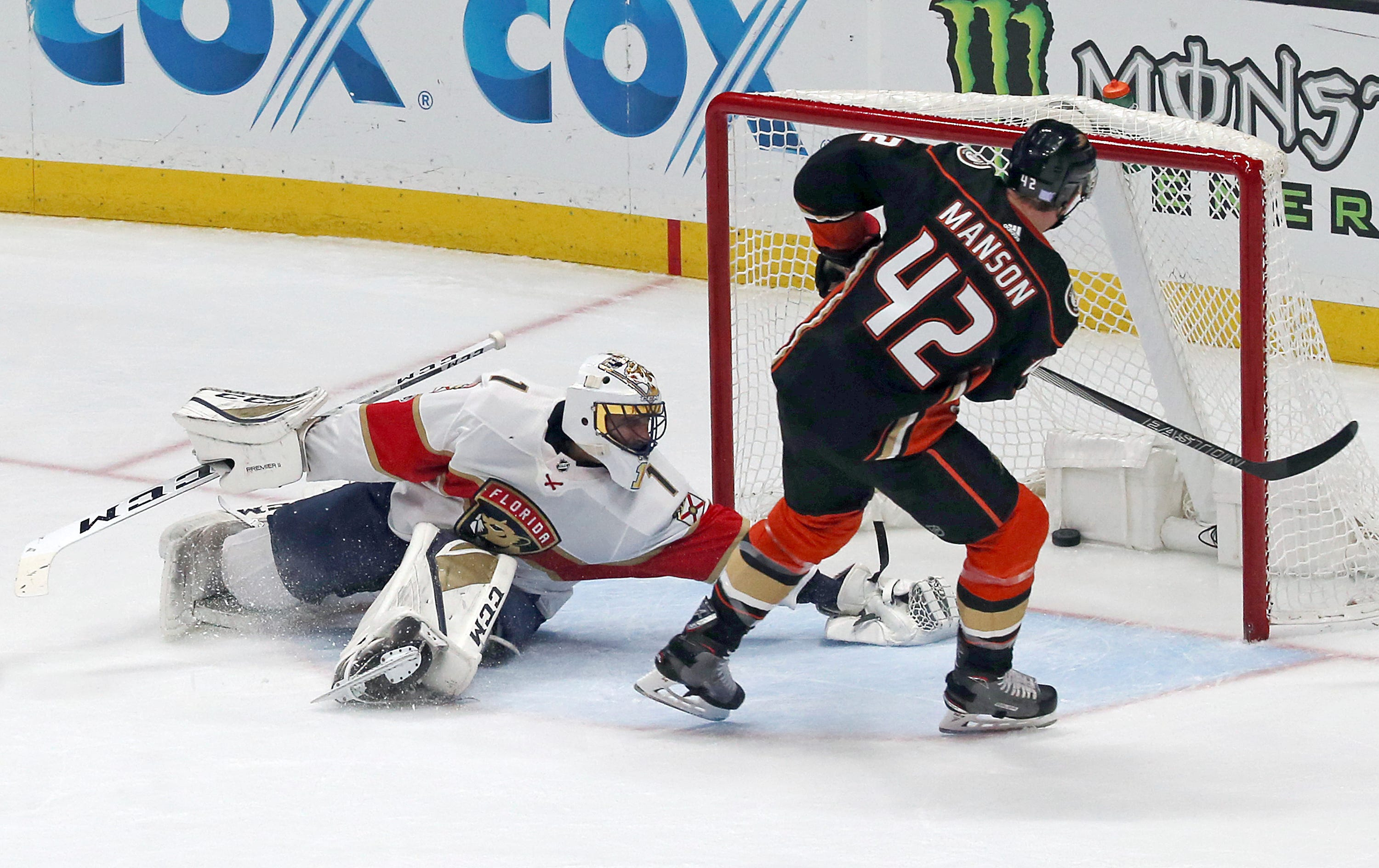 Gibson stops 50 shots in Ducks' 3-2 win over Panthers