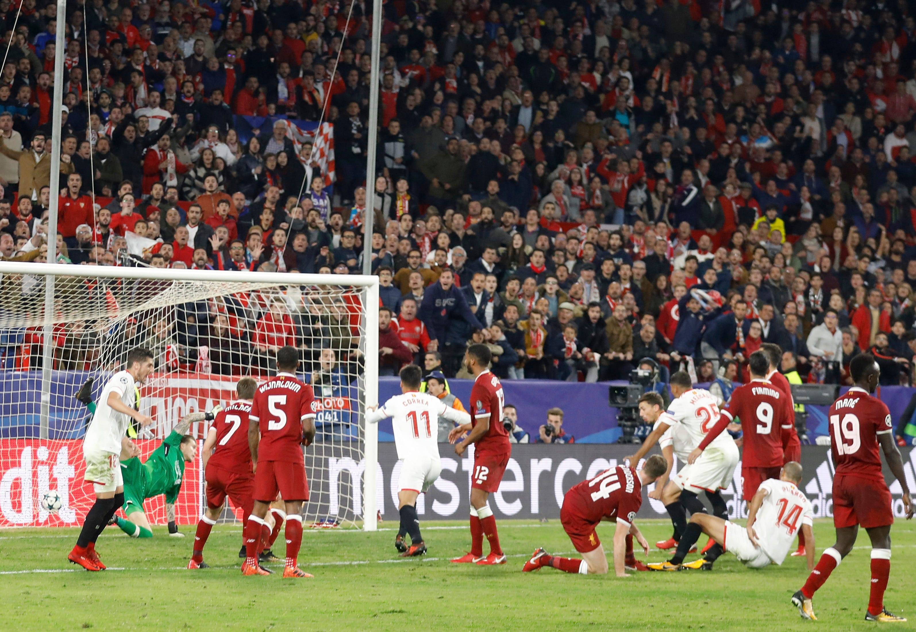 Sevilla draws after Liverpool wastes 3-goal lead in CL
