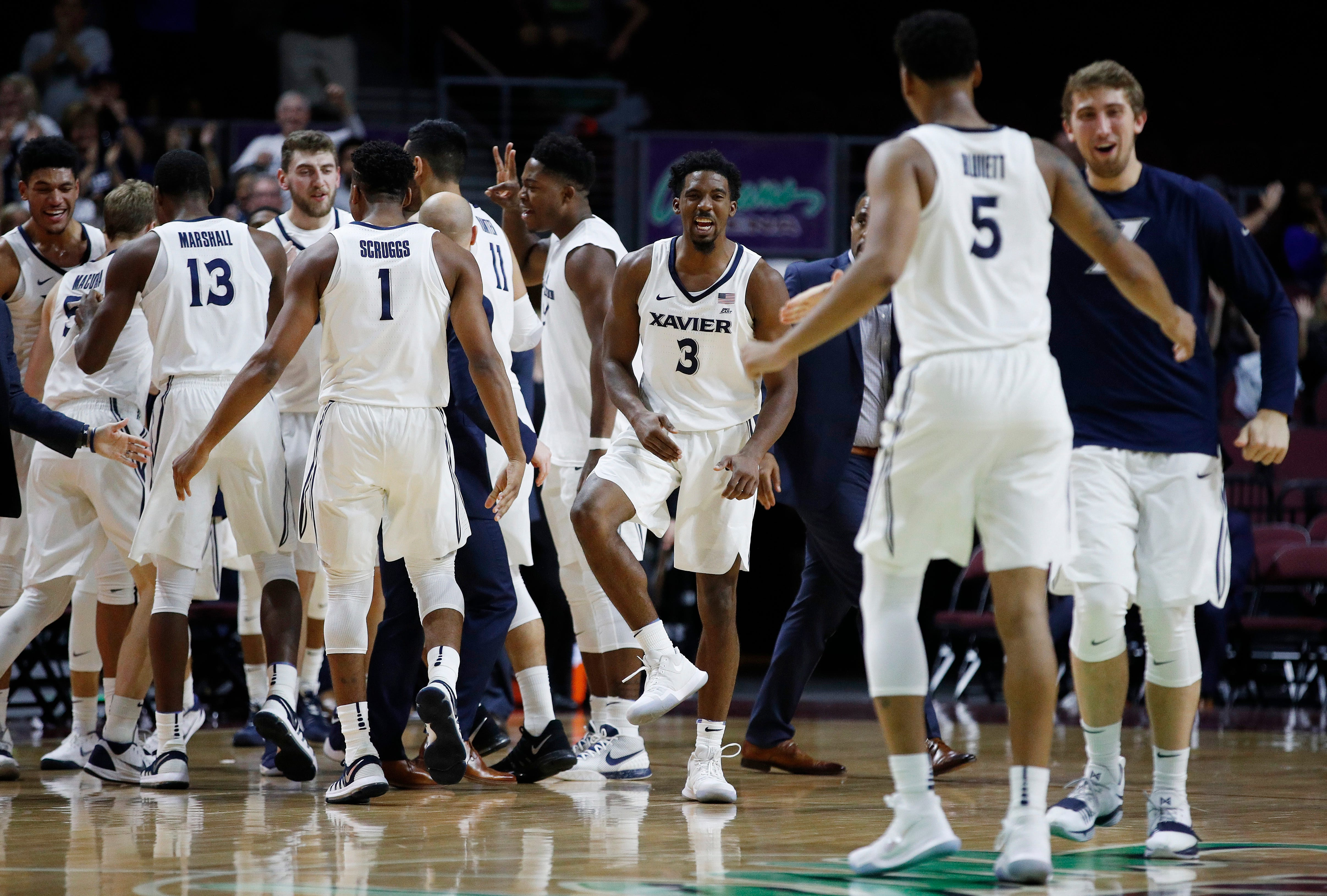 Xavier players celebrate after a play against Arizona