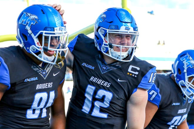 MTSU quarterback Brent Stockstill (12) and wide receiver C.J. Windham (81) celebrate a first-half touchdown against Old Dominion at Floyd Stadium on Nov. 25, 2017.