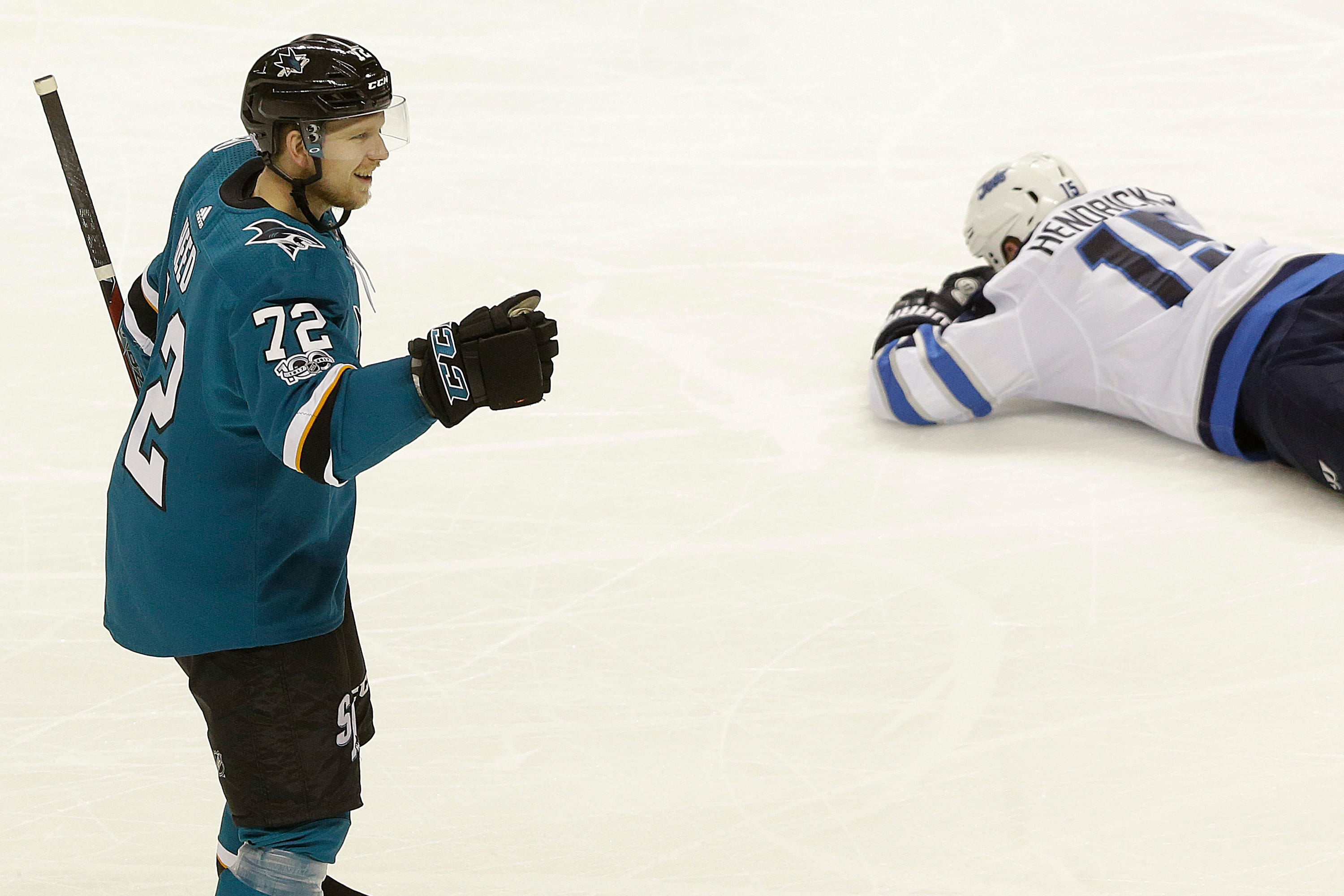 Couture scores twice as Sharks top Jets 4-0