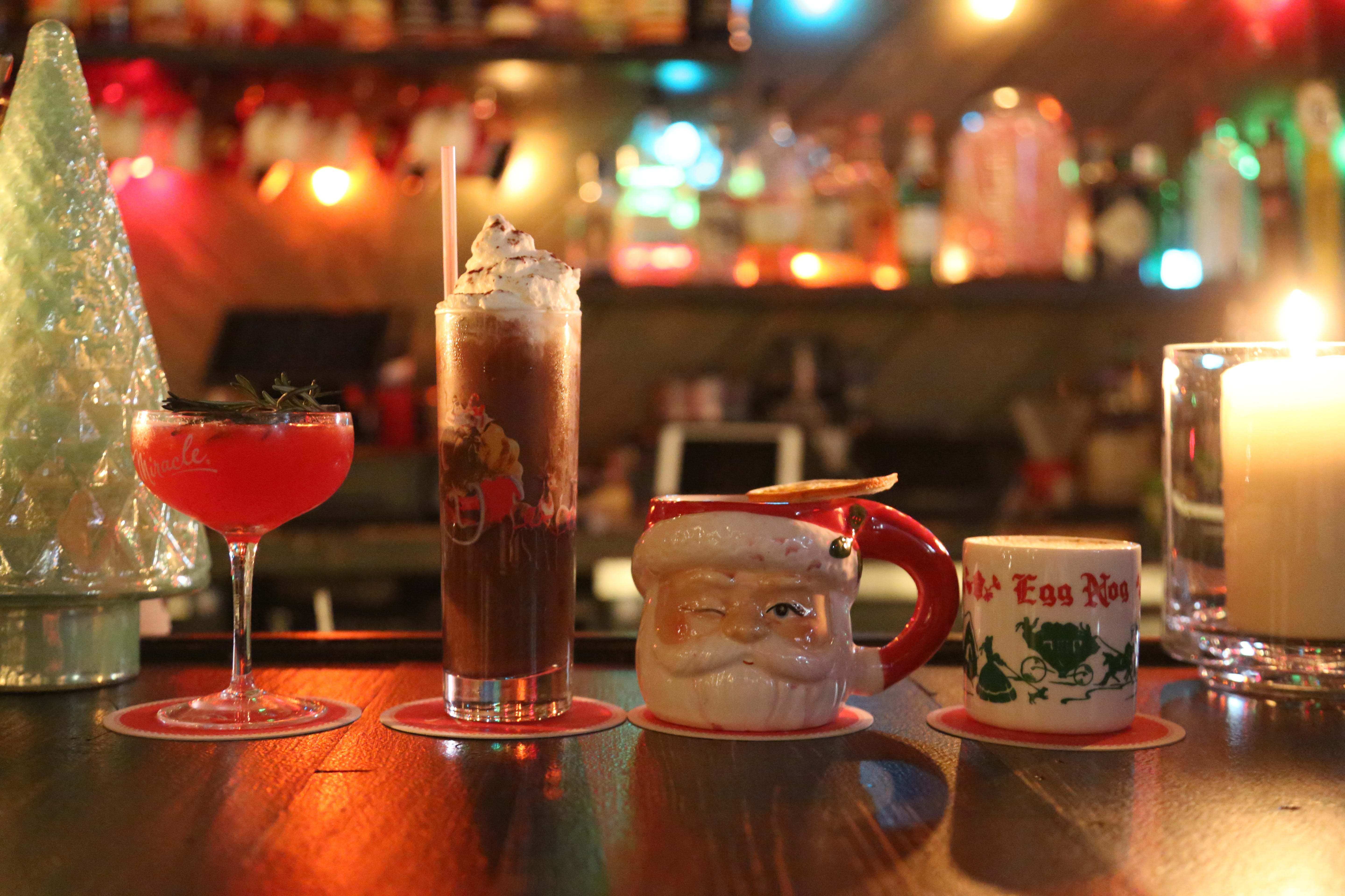Cocktails come in kitschy Christmas-themed glasses