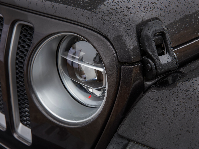 Headlights on the 2018 Jeep Wrangler Sahara are shown.