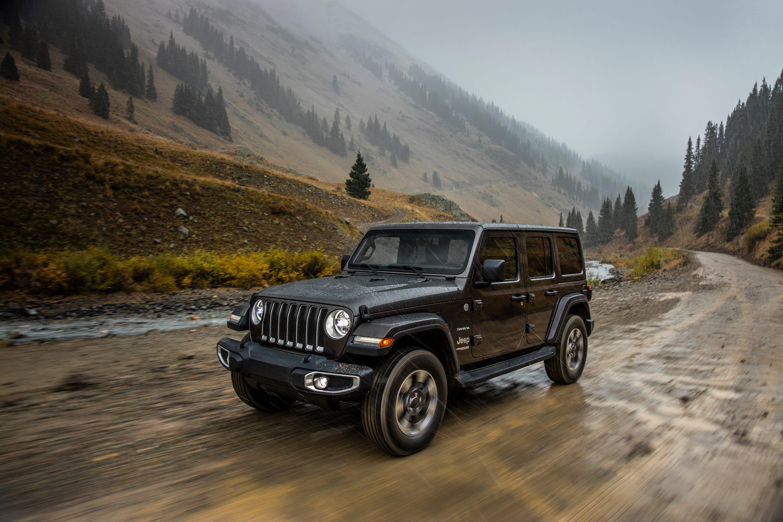 The 2018 Jeep Wrangler Sahara is shown. The 2018 Wrangler