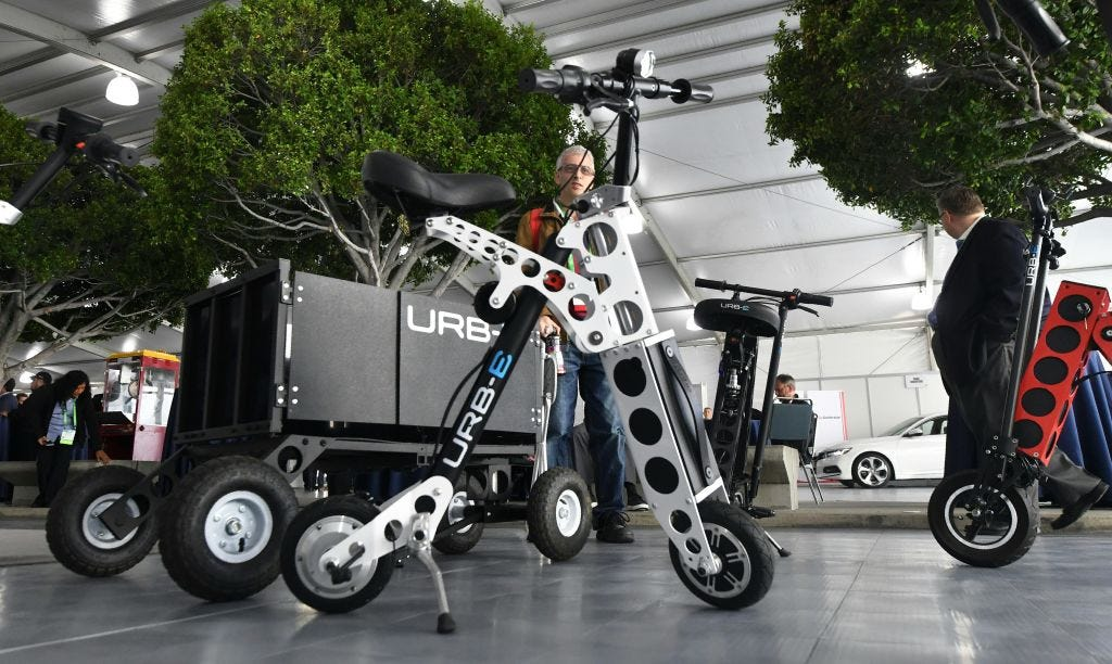 The URB-E electric folding bicycle is on display inside
