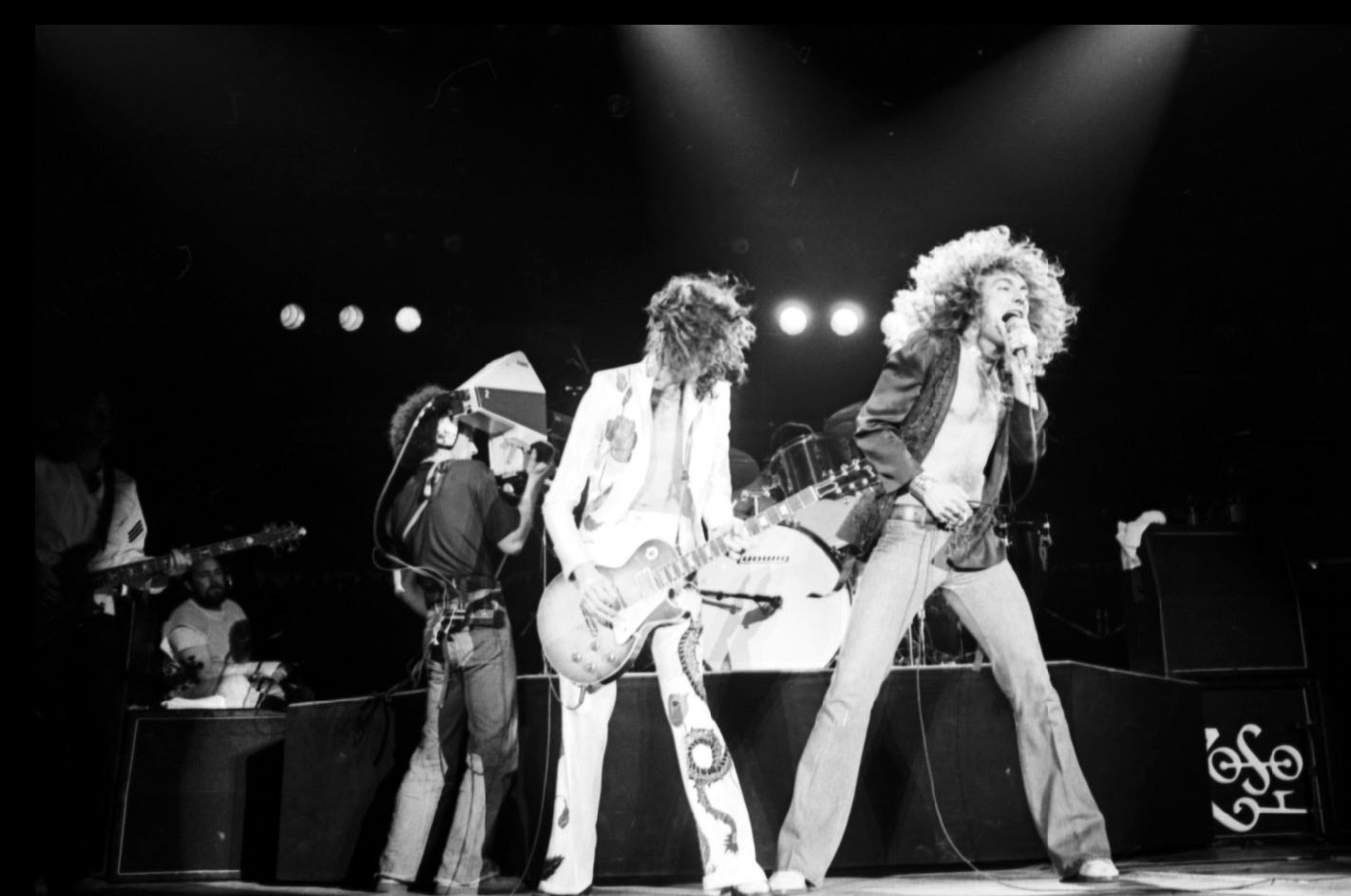 Led Zeppelin, with lead singer Robert Palmer, perform