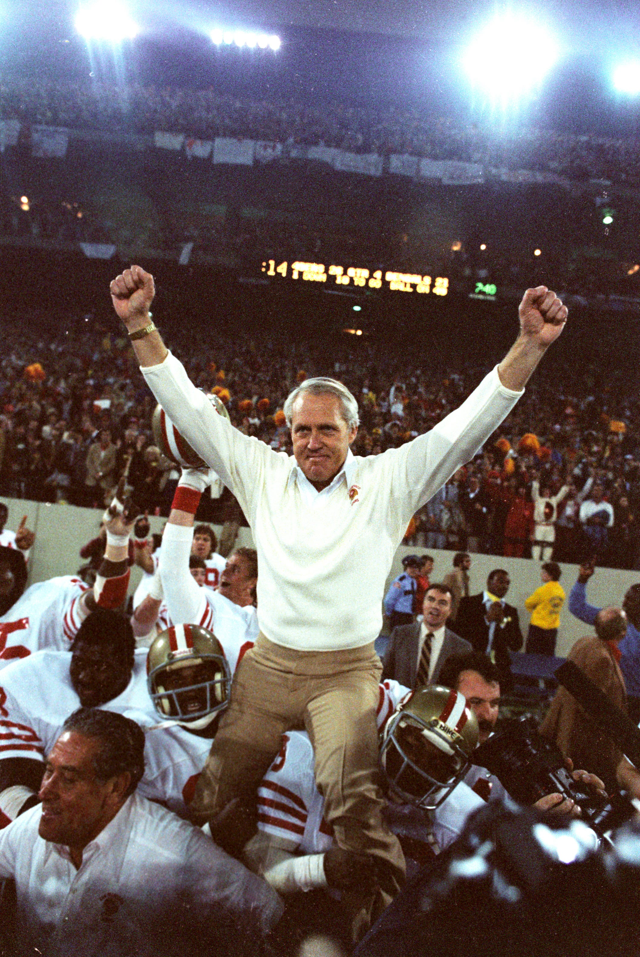 San Francisco 49ers coach Bill Walsh is carried off