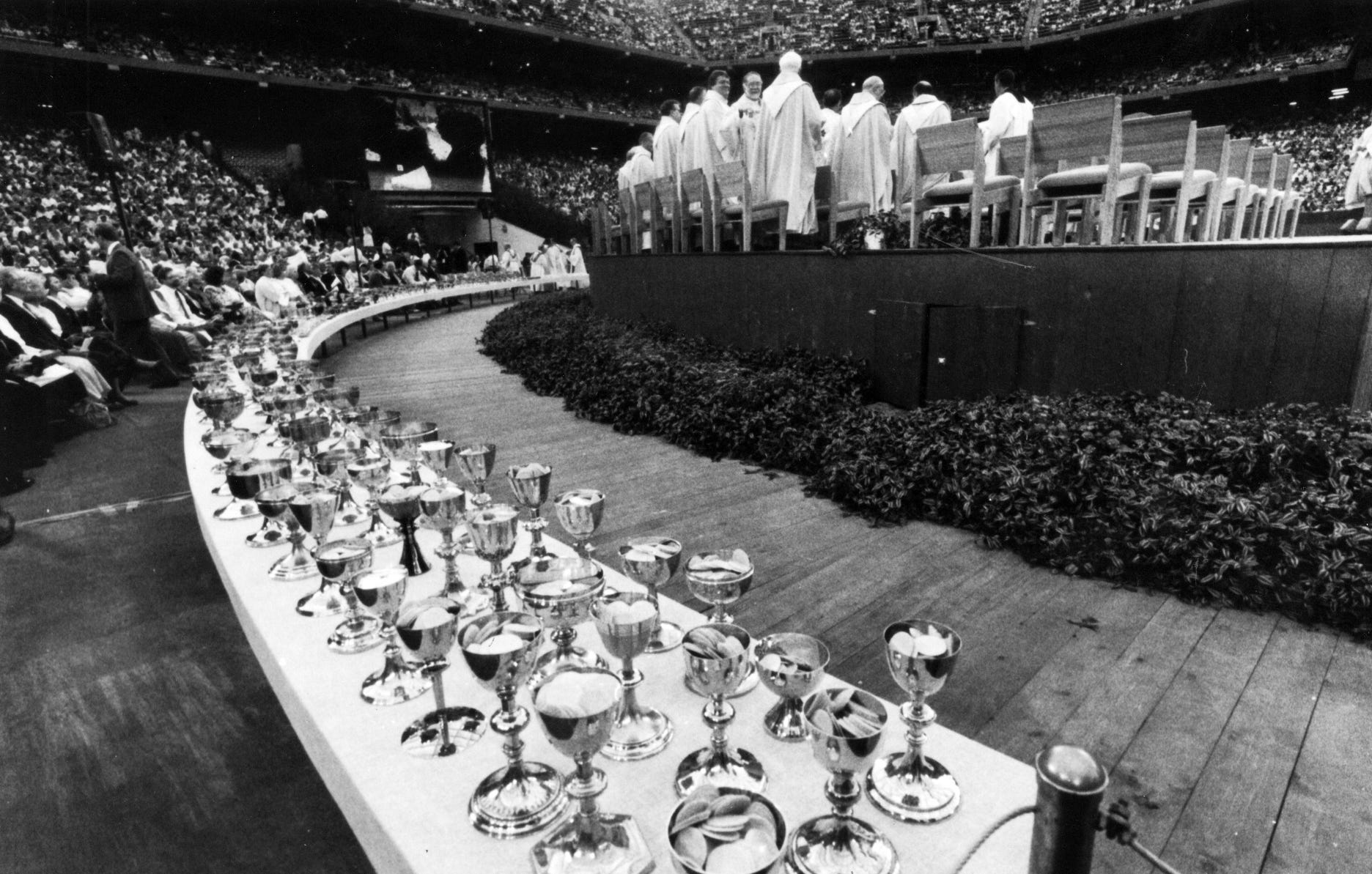 Chalices cover a table during the pope's mass in 1987.