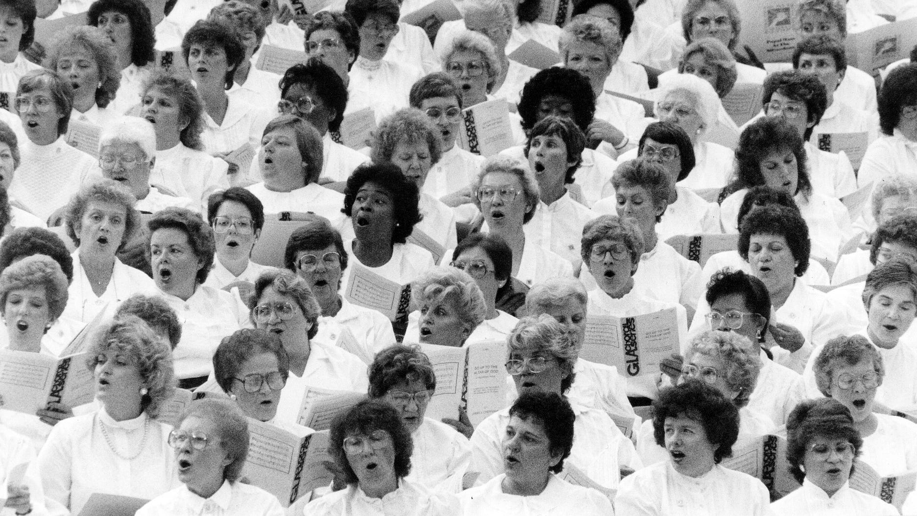 A choir sings during the pope's appearance at the Silverdome