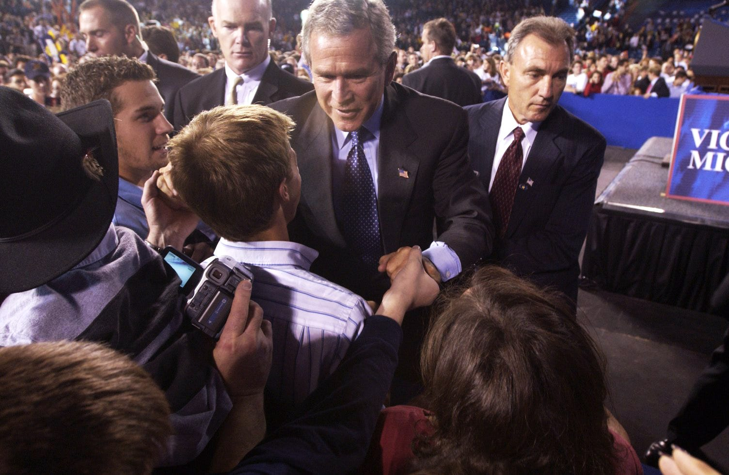 President George W. Bush greets supporters at the