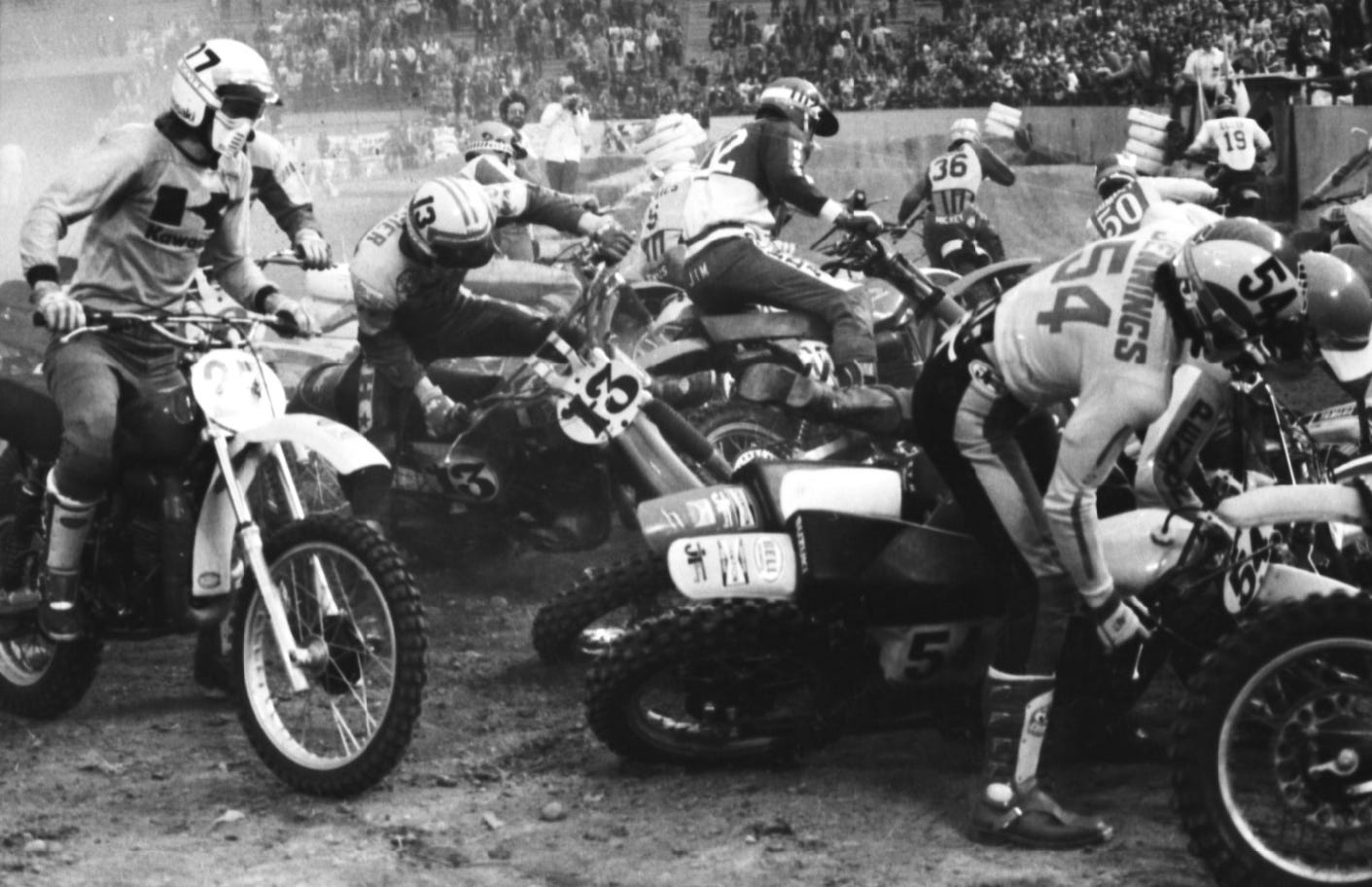It's a pileup of Supercross bikes and racers at the