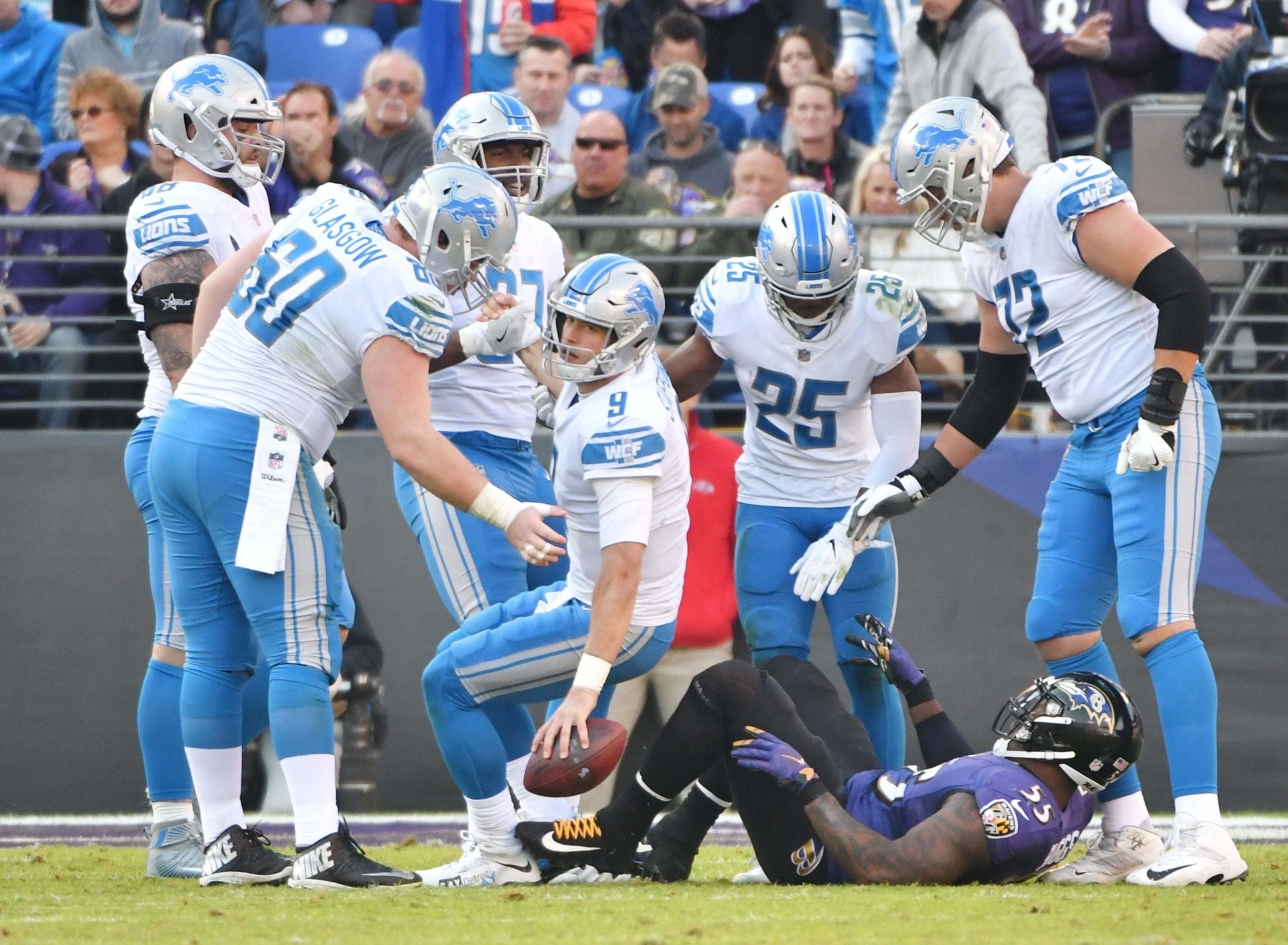 Lions' Matthew Stafford is helped by his offensive