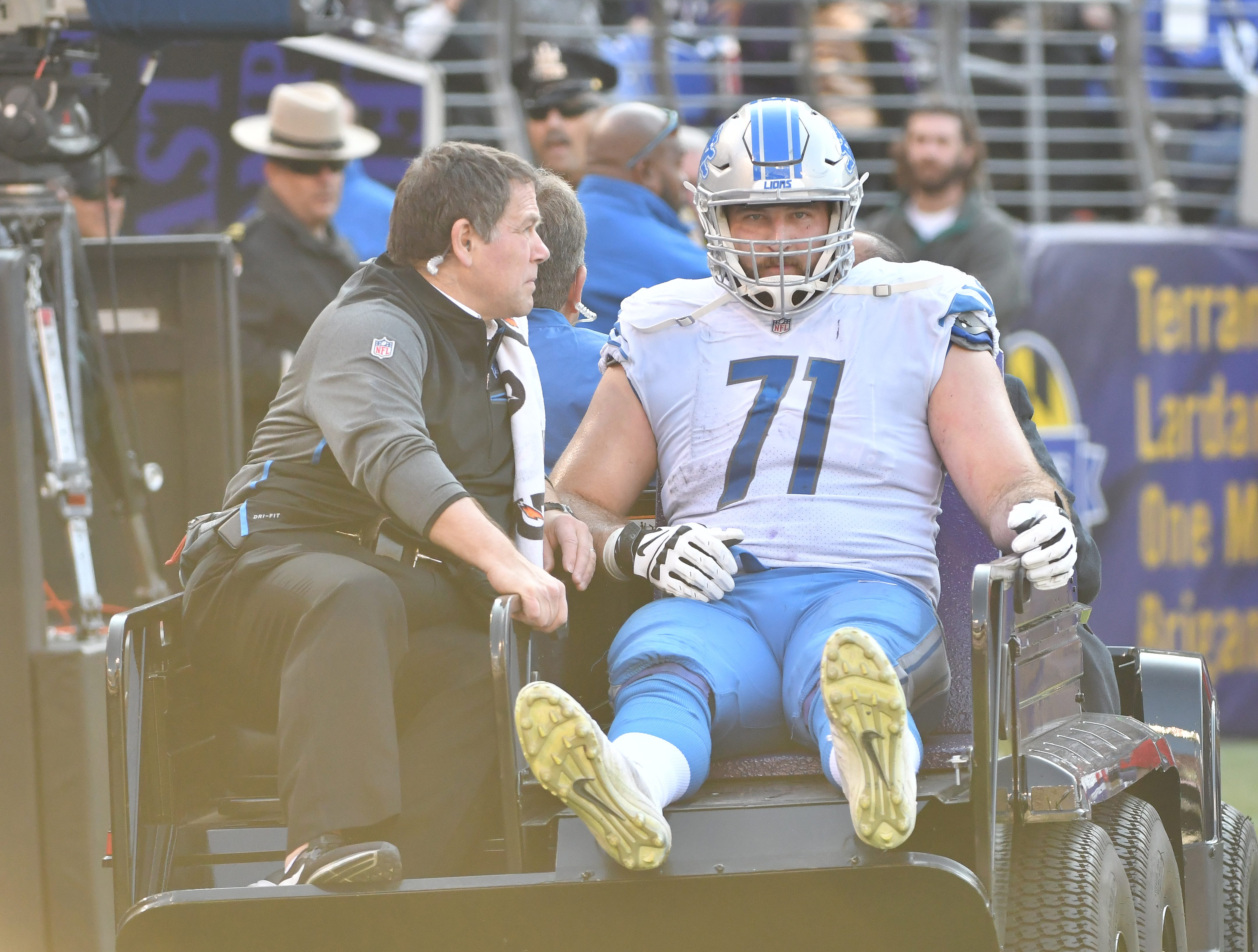 Lions' Rick Wagner is taken off the field in a cart