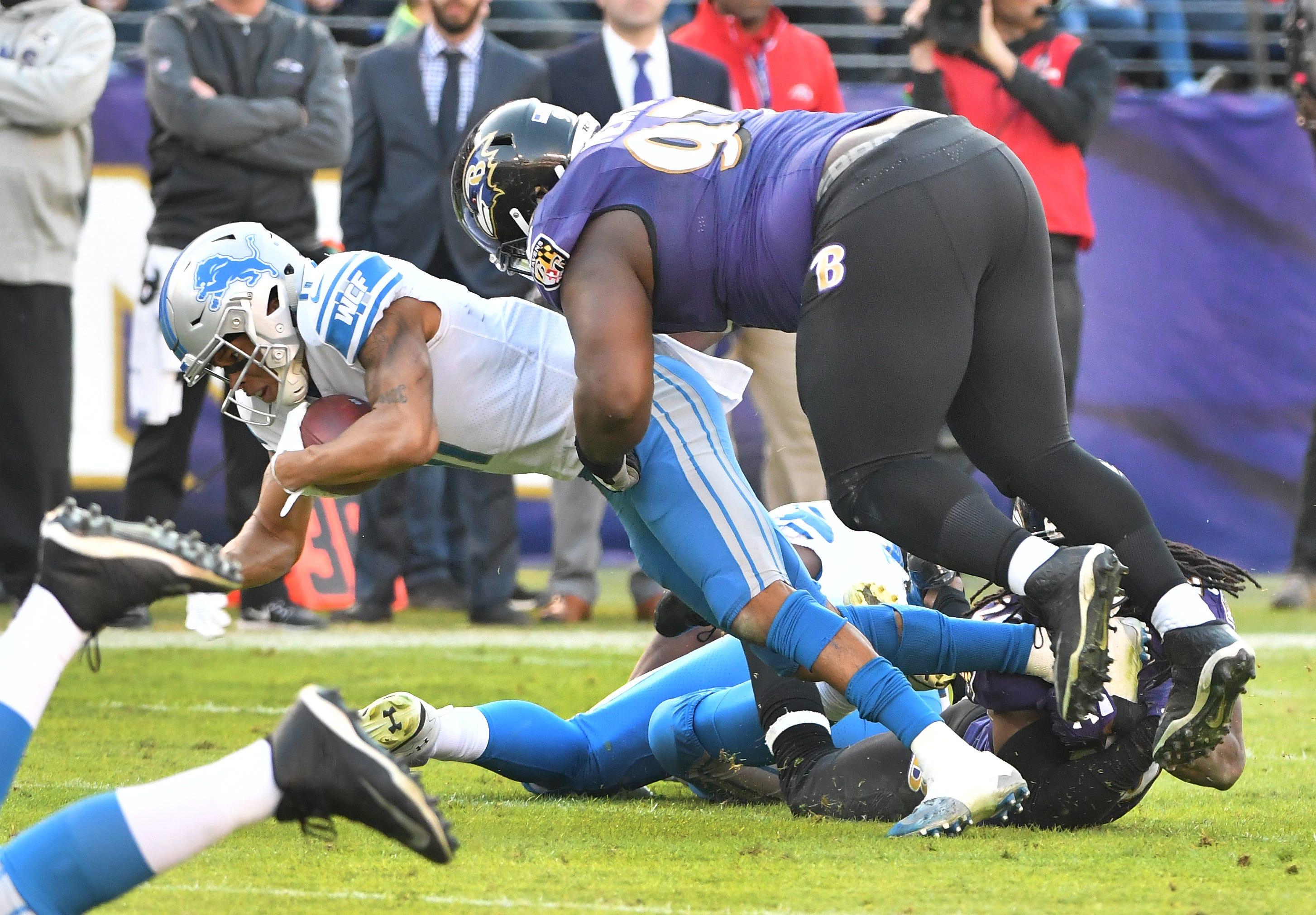 Lions' Marvin Jones Jr. is hit by Ravens' Michael Pierce
