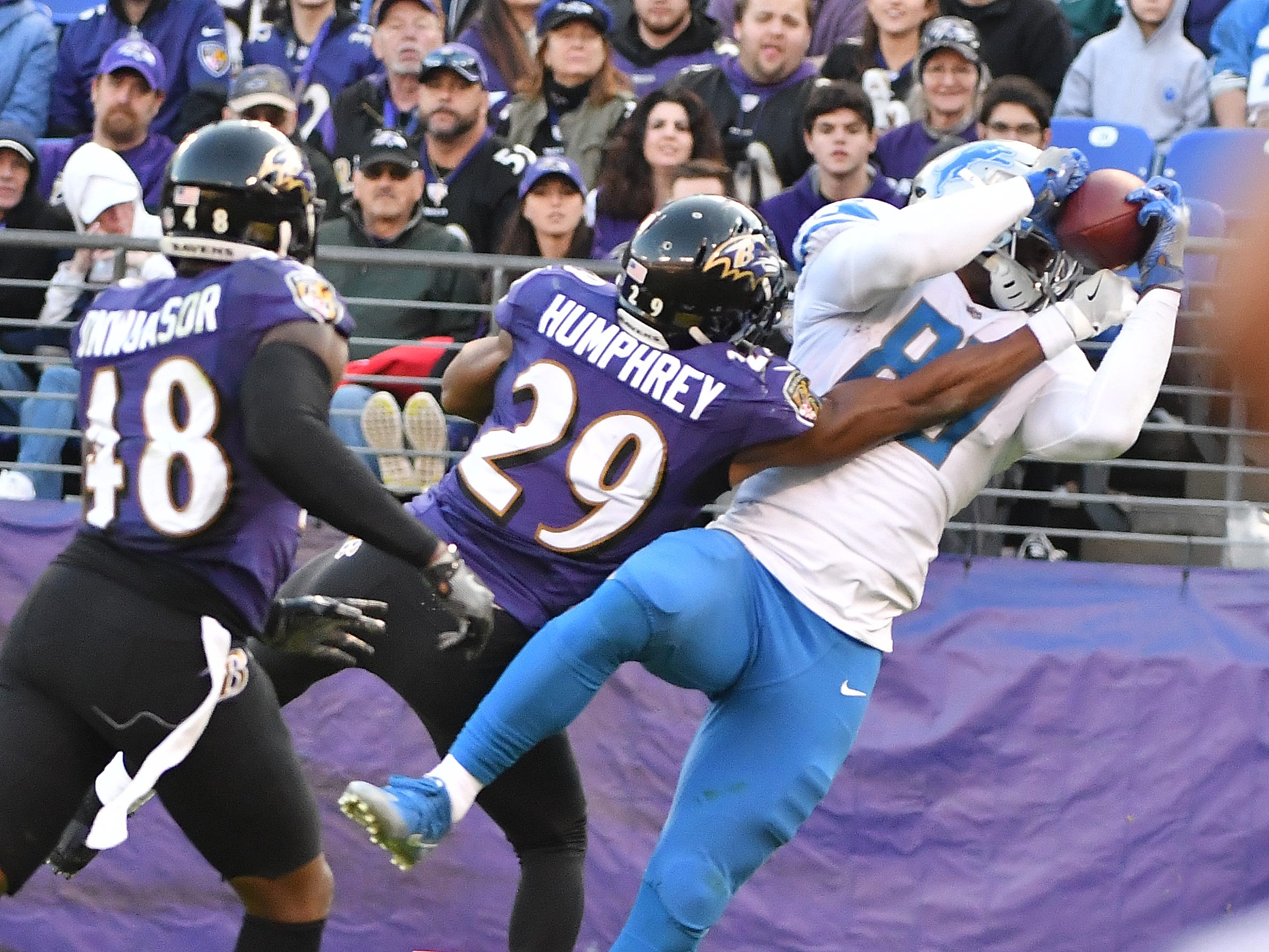 Lions' Michael Roberts makes a reception against his